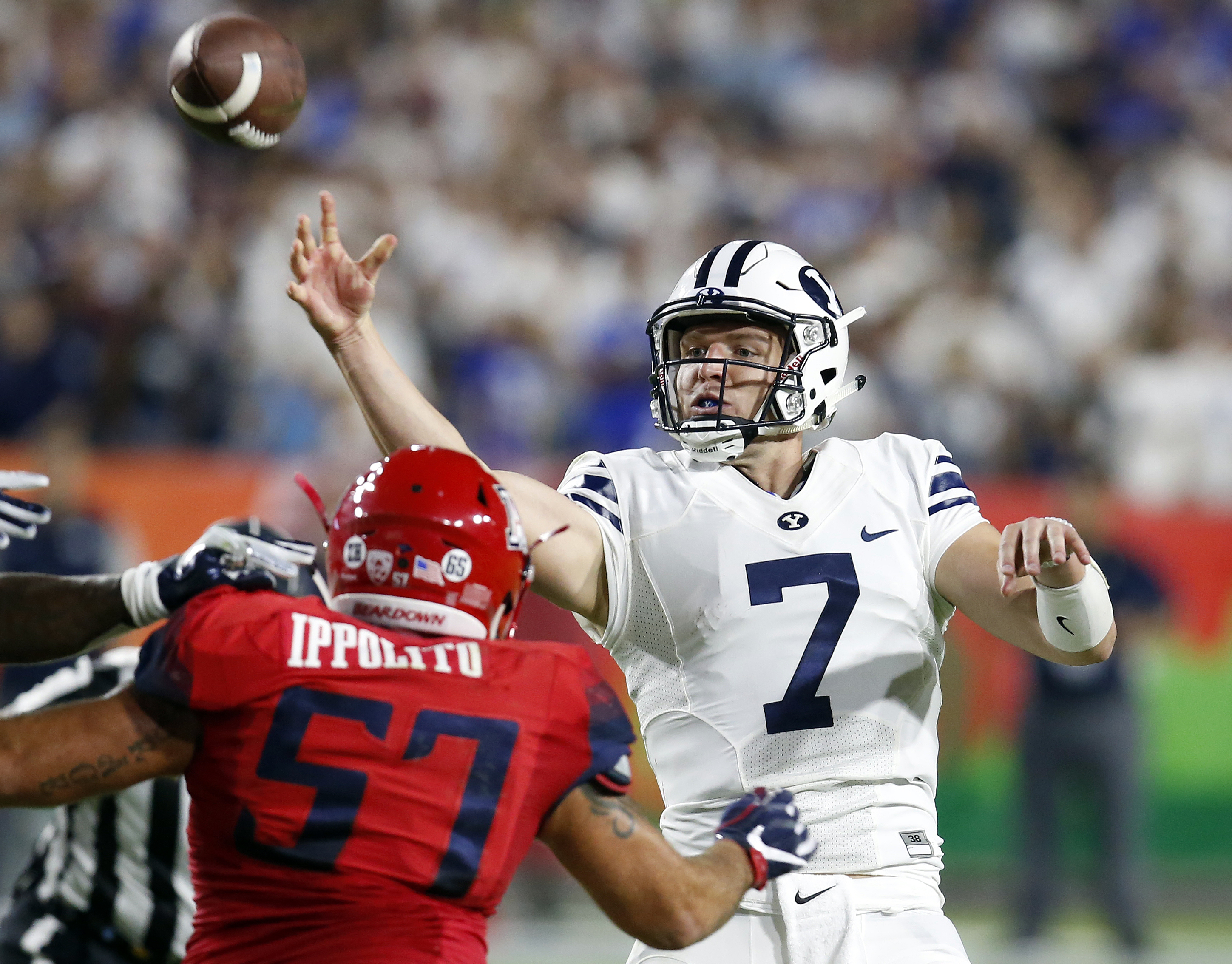 BYU quarterback Taysom Hill (7) throws during the first half against Arizona in an NCAA college football game, Saturday, Sept. 3, 2016, in Phoenix. (AP Photo/Rick Scuteri)