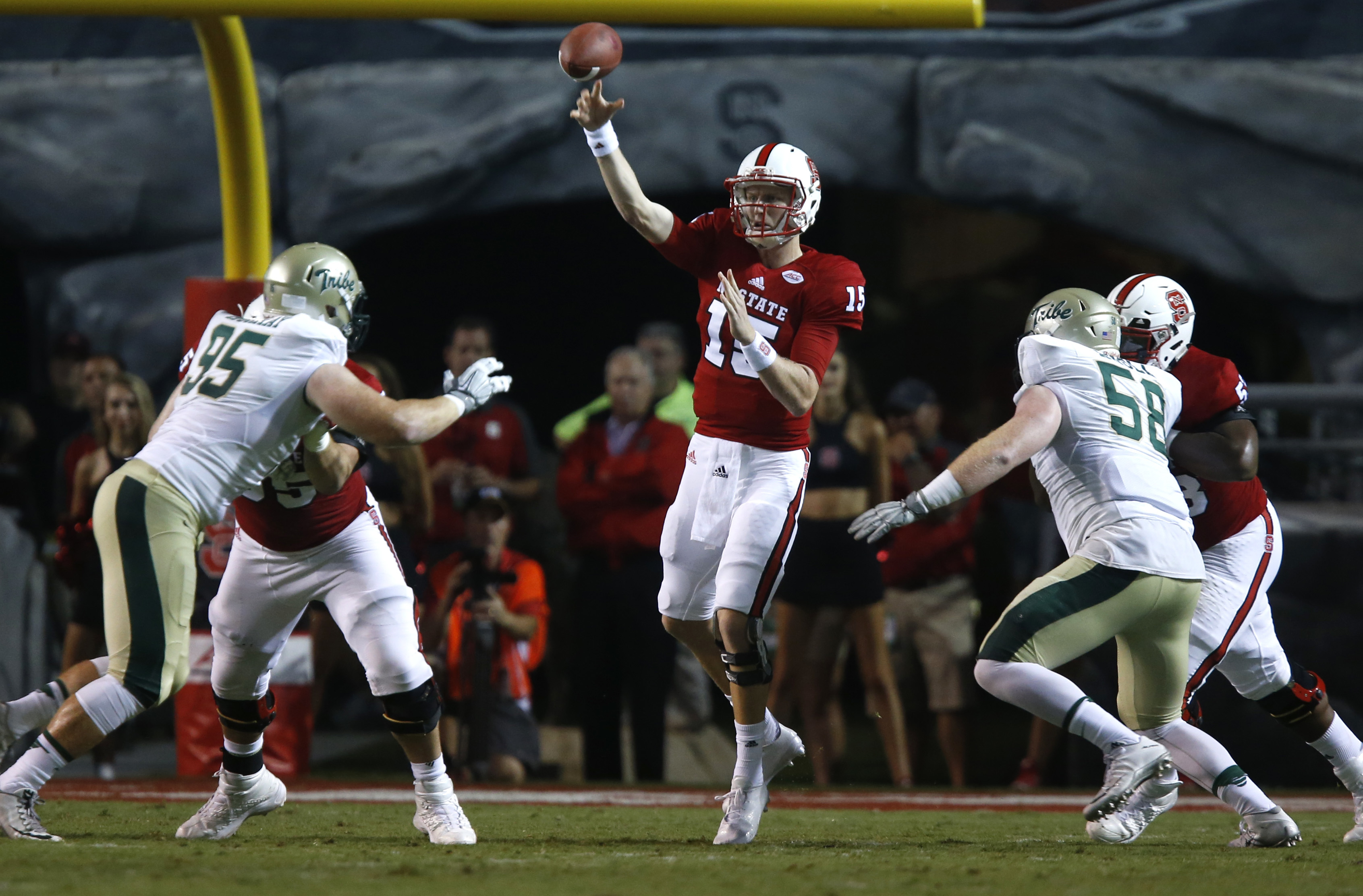 FILE - In this Sept. 1, 2016, file photo, North Carolina State quarterback Ryan Finley (15) passes during the first half of an NCAA college football game against William & Mary,  at Carter-Finley Stadium in Raleigh, N.C. North Carolina State seems to have