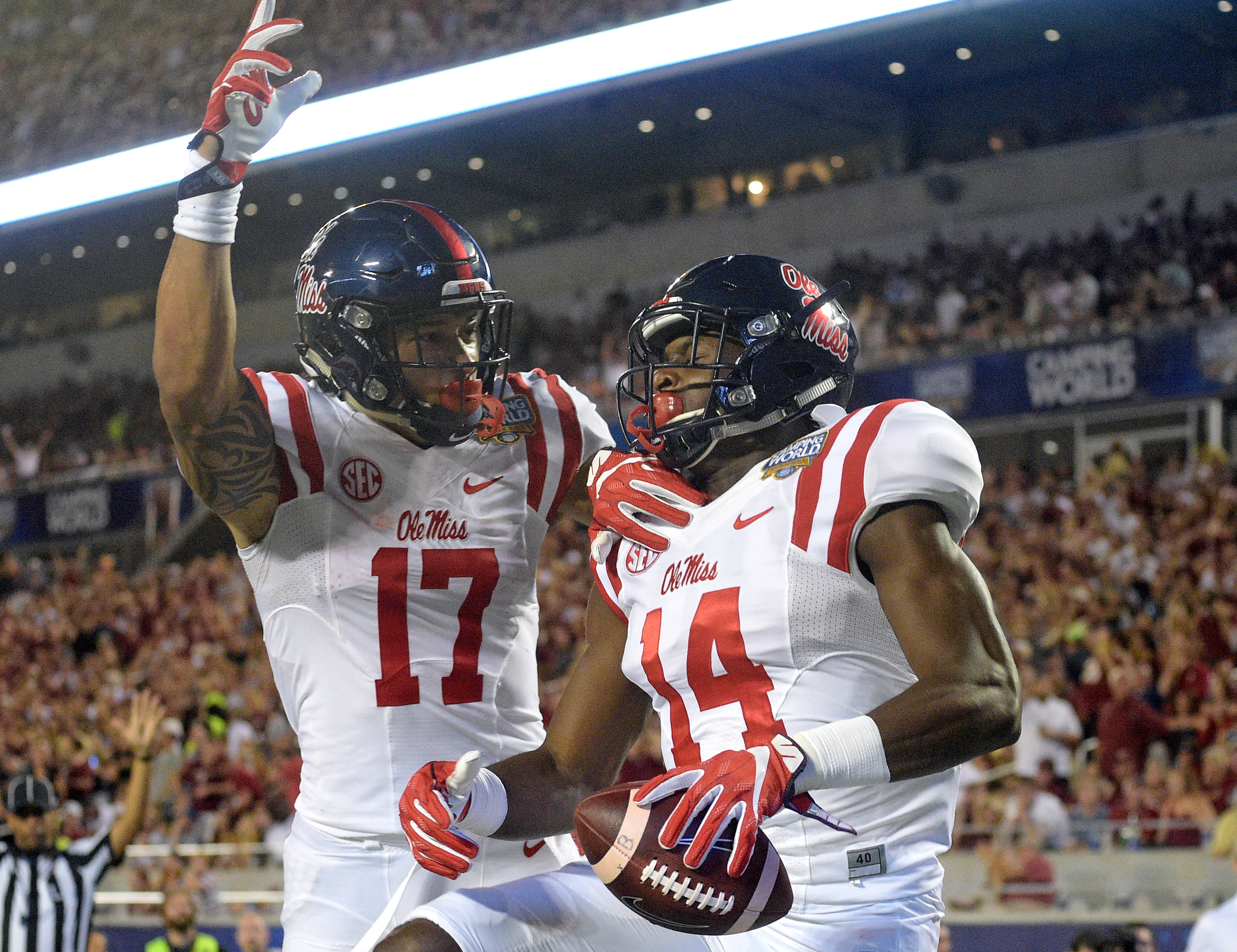 Mississippi wide receiver D.K. Metcalf (14) celebrates his 3-yard touchdown reception against Florida State with tight end Evan Engram (17) during the first half of an NCAA college football game, Monday, Sept. 5, 2016, in Orlando, Fla. (AP Photo/Phelan M.