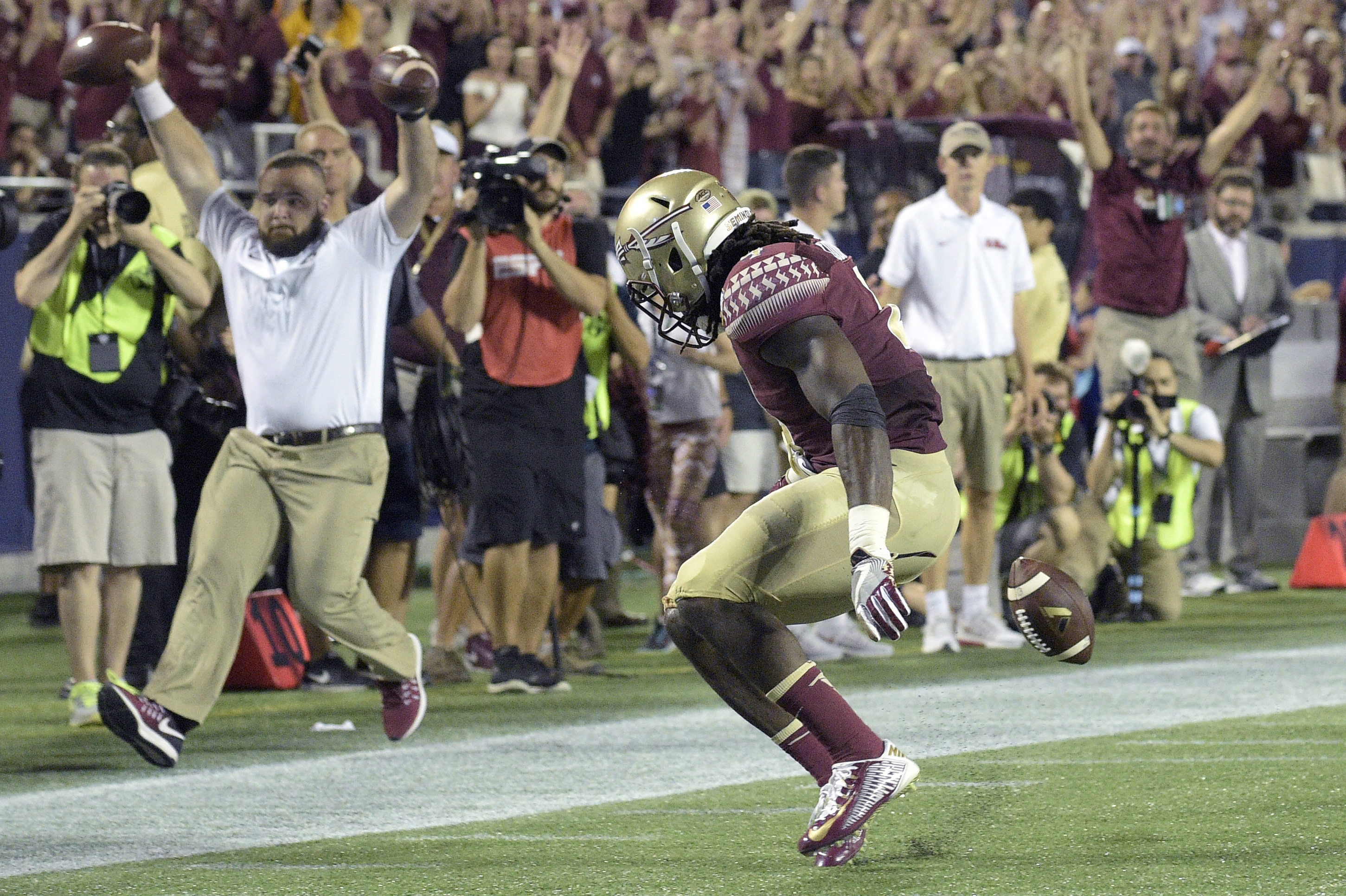 Florida State running back Dalvin Cook, front, fumbles the ball short of the goal line after catching a pass during the first half of an NCAA college football game against Mississippi in Orlando, Fla., Monday, Sept. 5, 2016. The ball went out of bounds an
