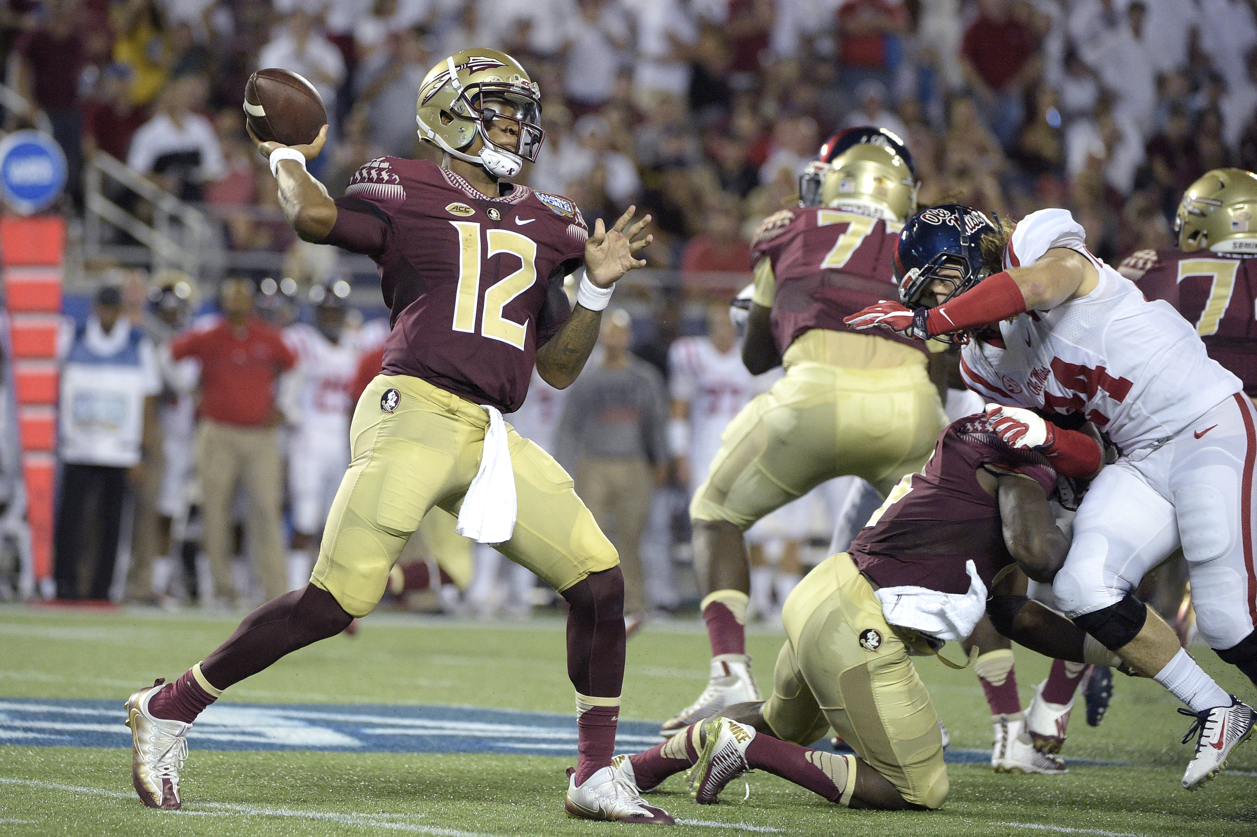 Florida State quarterback Deondre Francois (12) throws a pass as he is rushed by Mississippi linebacker Alex Ashlock (44) during the first half of an NCAA college football game in Orlando, Fla., Monday, Sept. 5, 2016.(AP Photo/Phelan M. Ebenhack)