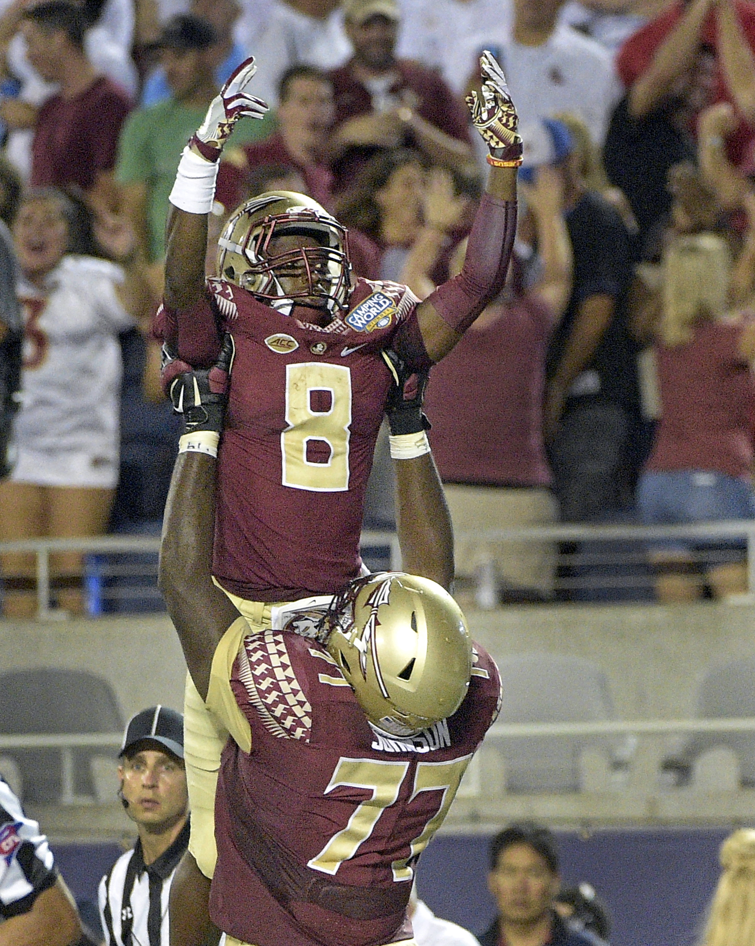 Florida State offensive lineman Roderick Johnson (77) lifts up wide receiver Kermit Whitfield (8) after Whitfield scored a touchdown against Mississippi during the second half of an NCAA college football game, Monday, Sept. 5, 2016, in Orlando, Fla. (AP P