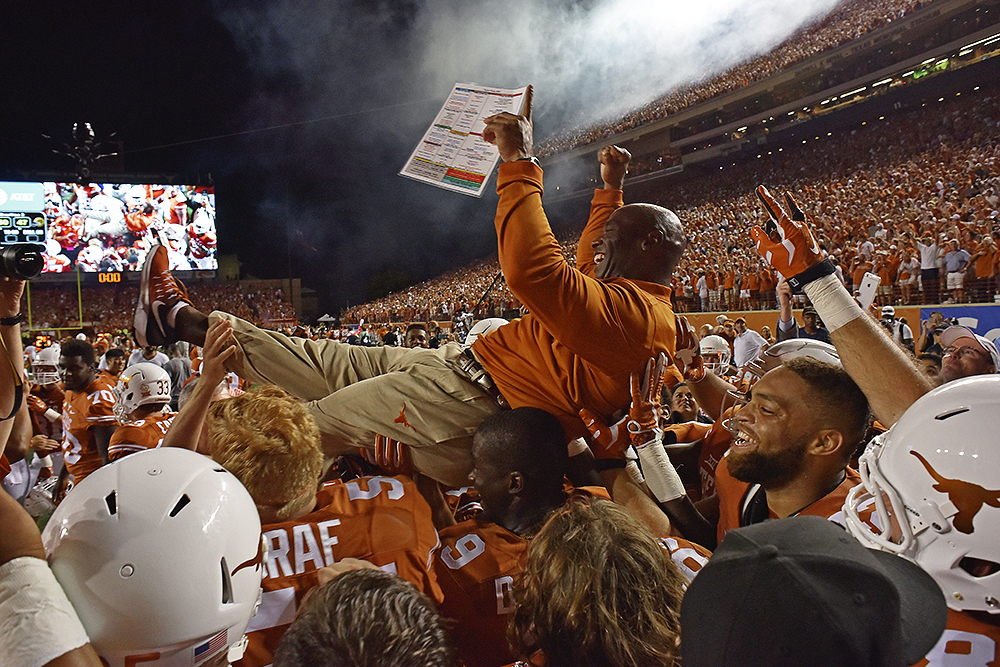 FILE - In this Sept. 4, 2016, file photo, Texas head coach Charlie Strong is carried by players after defeating Notre Dame in double overtime of an NCAA college football game, in Austin, Texas. Texas is ranked for the first time under coach Charlie Strong
