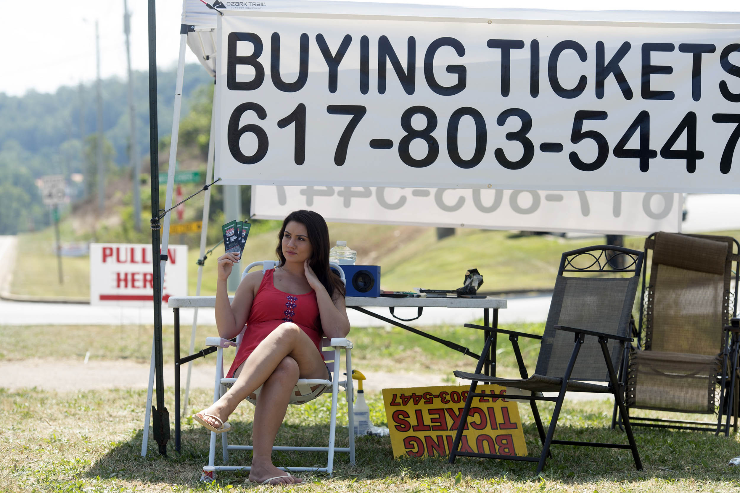 Scarlett Hodge offers tickets for for sale along Highway 394 Wednesday, Sept. 7, 2016, in Blountville, Tenn, for the Pilot Flying J Battle at Bristol at Bristol Motor Speedway on Saturday when Tennessee and Virginia Tech will play in an NCAA college footb