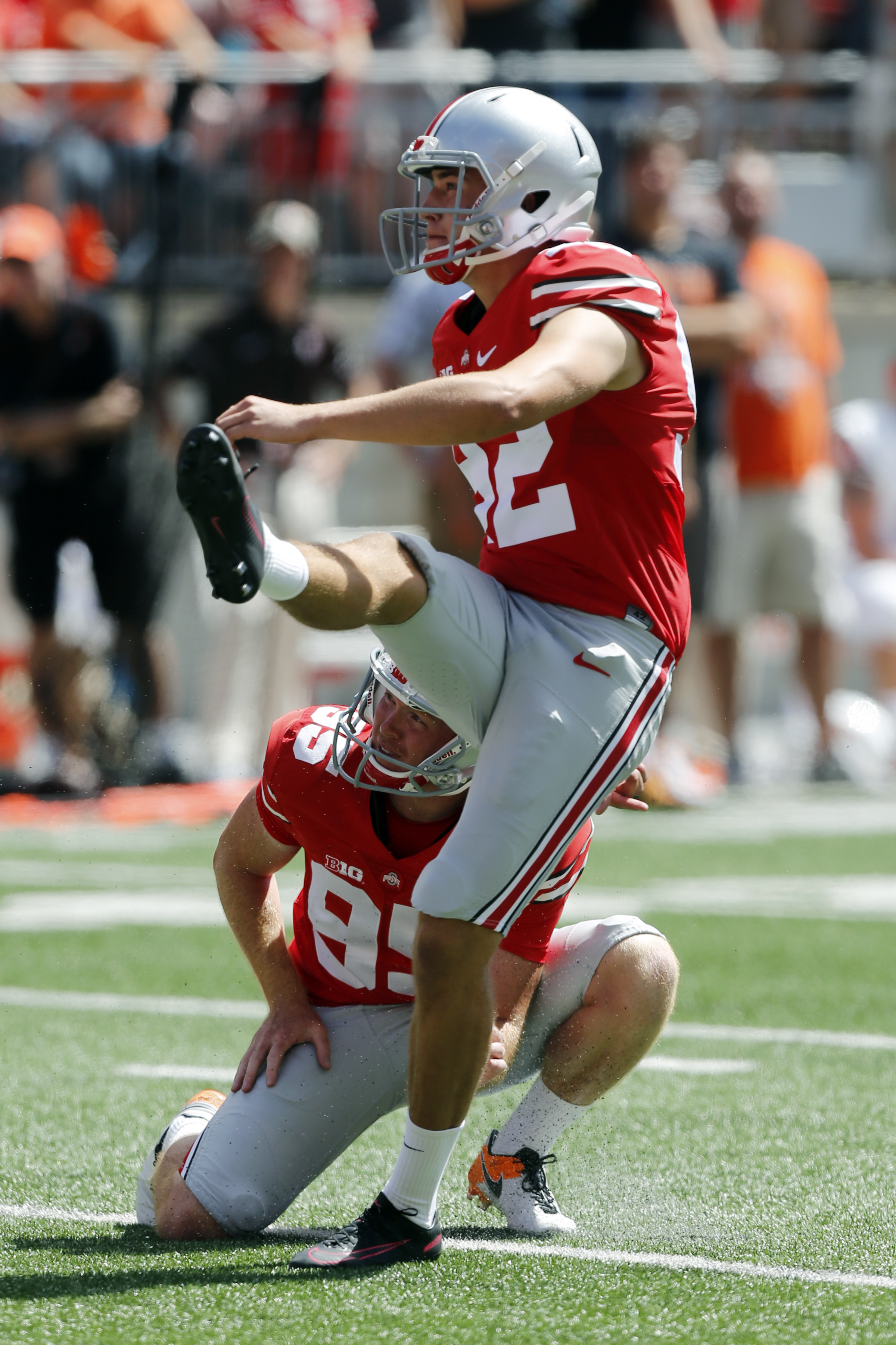 FILE - In this Sept. 3, 2016, file photo, Ohio State kicker Tyler Durbin, front, and holder Cameron Johnston watch Durbin's extra point attempt during the first half of their NCAA college football game against Bowling Green Saturday, Sept. 3, 2016, in Col