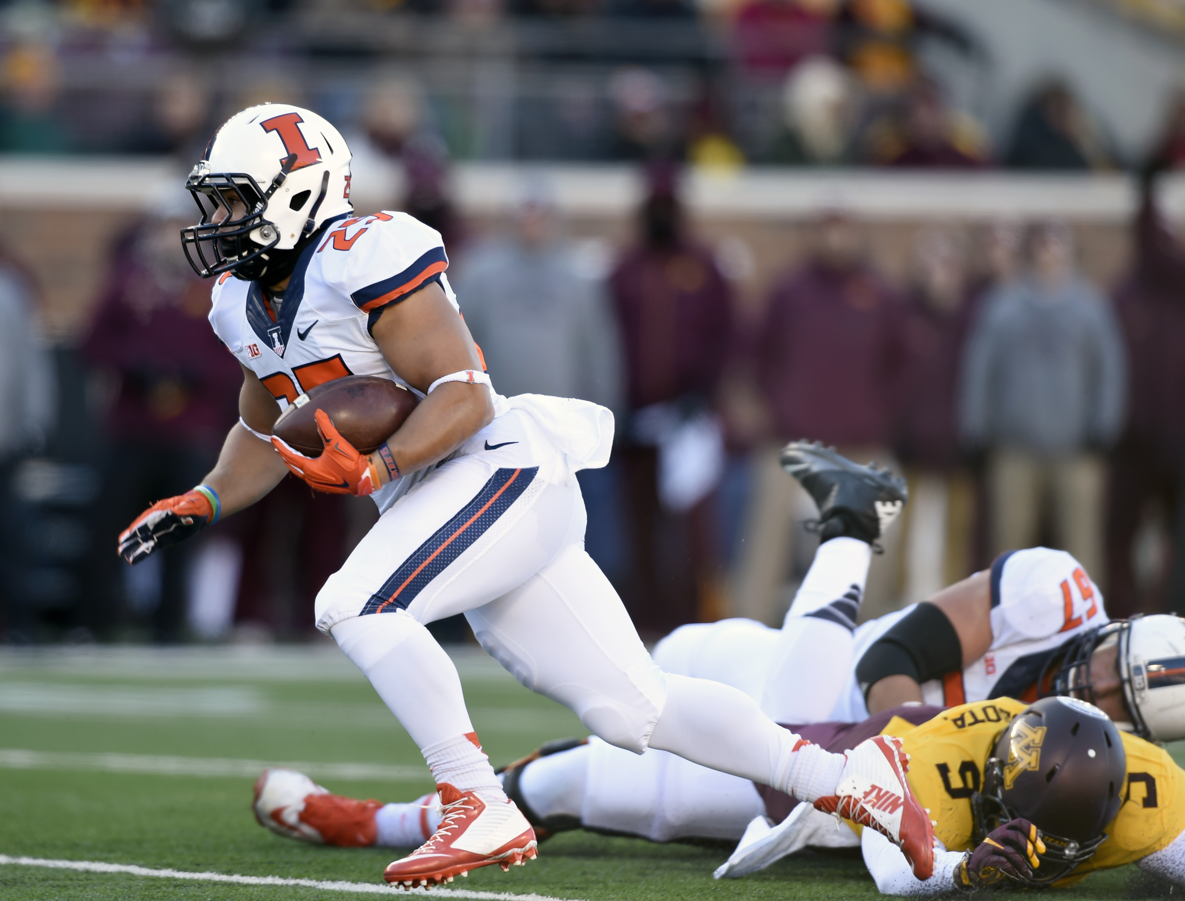 FILE - In this Nov. 21, 2015, file photo, Illinois' running back Kendrick Foster (25) carries the ball against Minnesota during an NCAA college football game in Minneapolis. As a high school player in Peoria, Ill., big games and big runs were normal for F