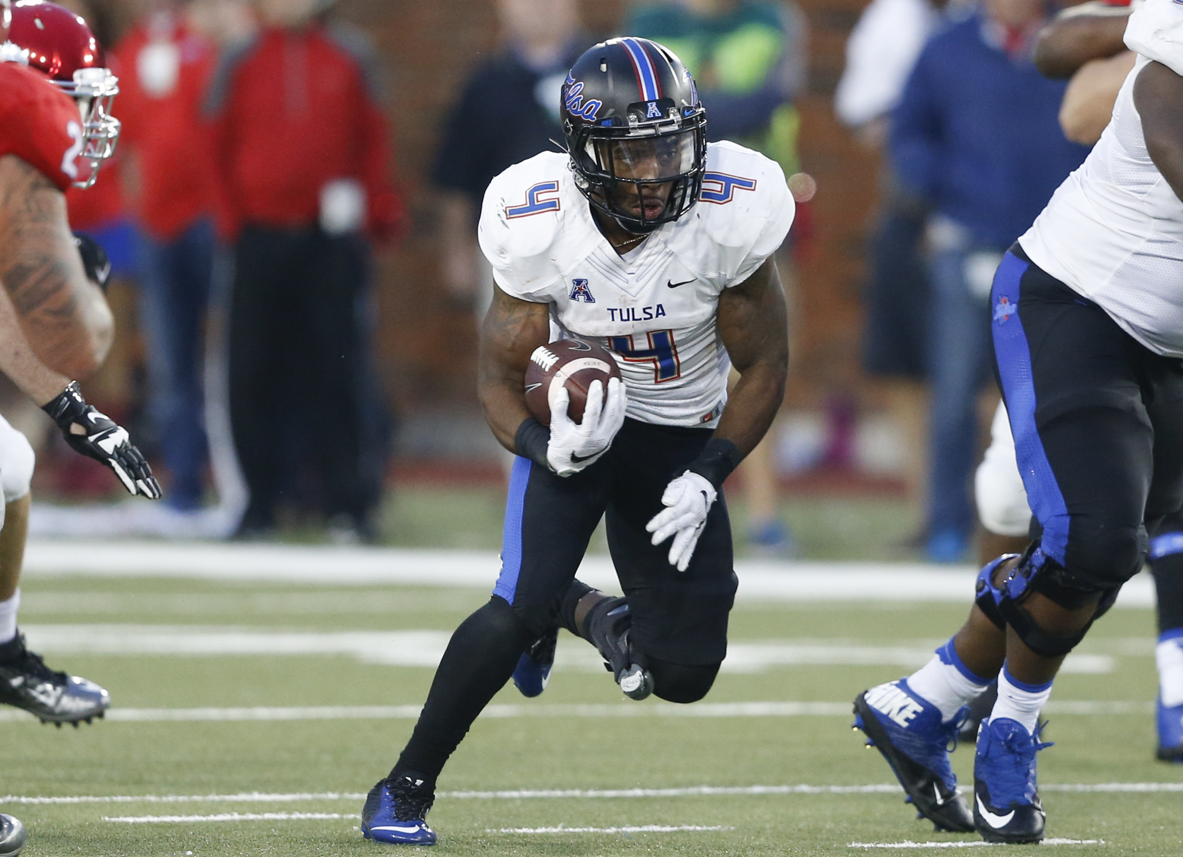 FILE - In this Oct. 31, 2015, file photo, Tulsa running back D'Angelo Brewer (4) runs against SMU during the second half of an NCAA college football game, in Dallas. Brewer rushed for 164 yards and three touchdowns last week on 22 carries. Tulsa will be a
