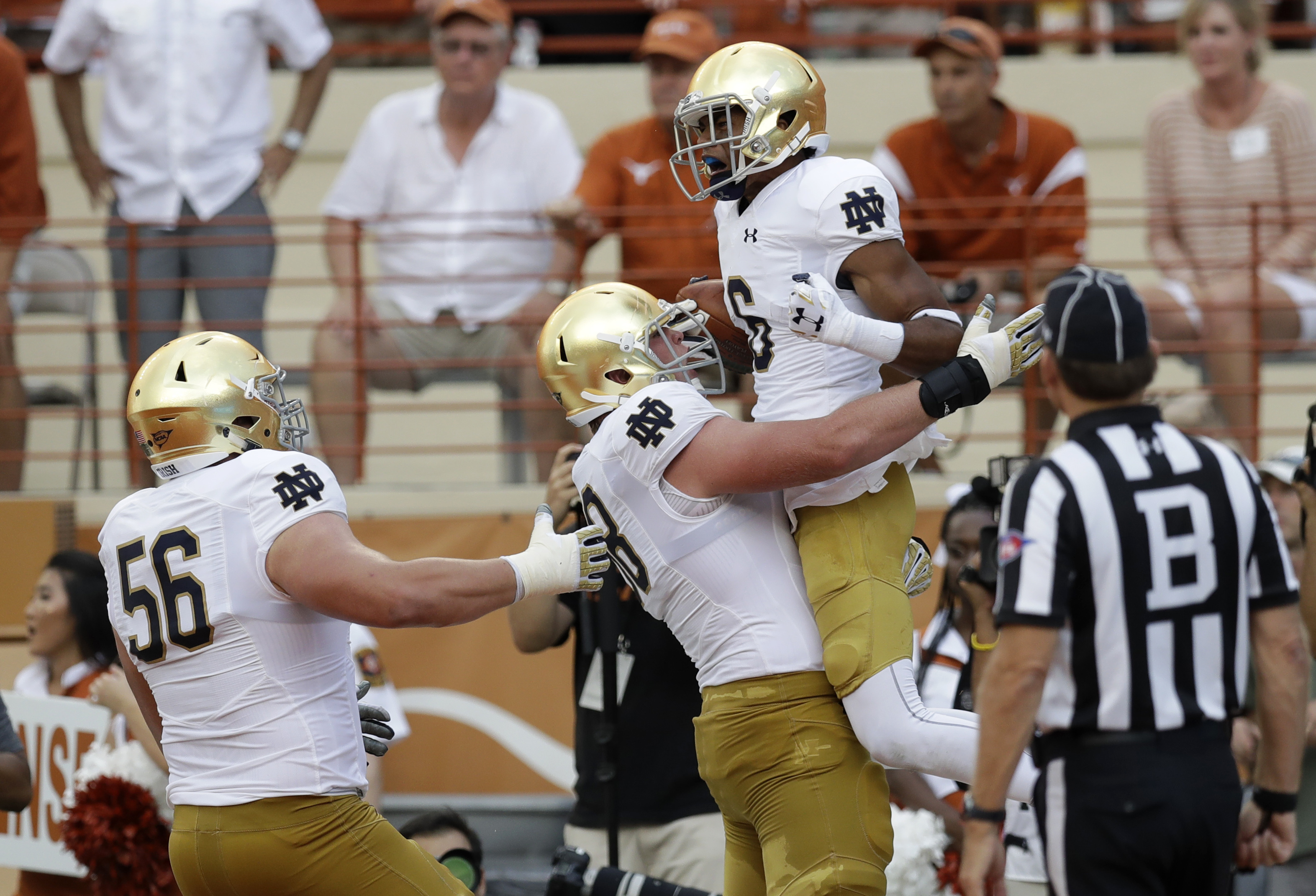 In this Sept. 4, 2016 file photo, Notre Dame wide receiver Equanimeous St. Brown, right, celebrates with teammates after catching a 19-yard touchdown pass during during an NCAA college football game in Austin, Texas. The wide receiver is living up to his