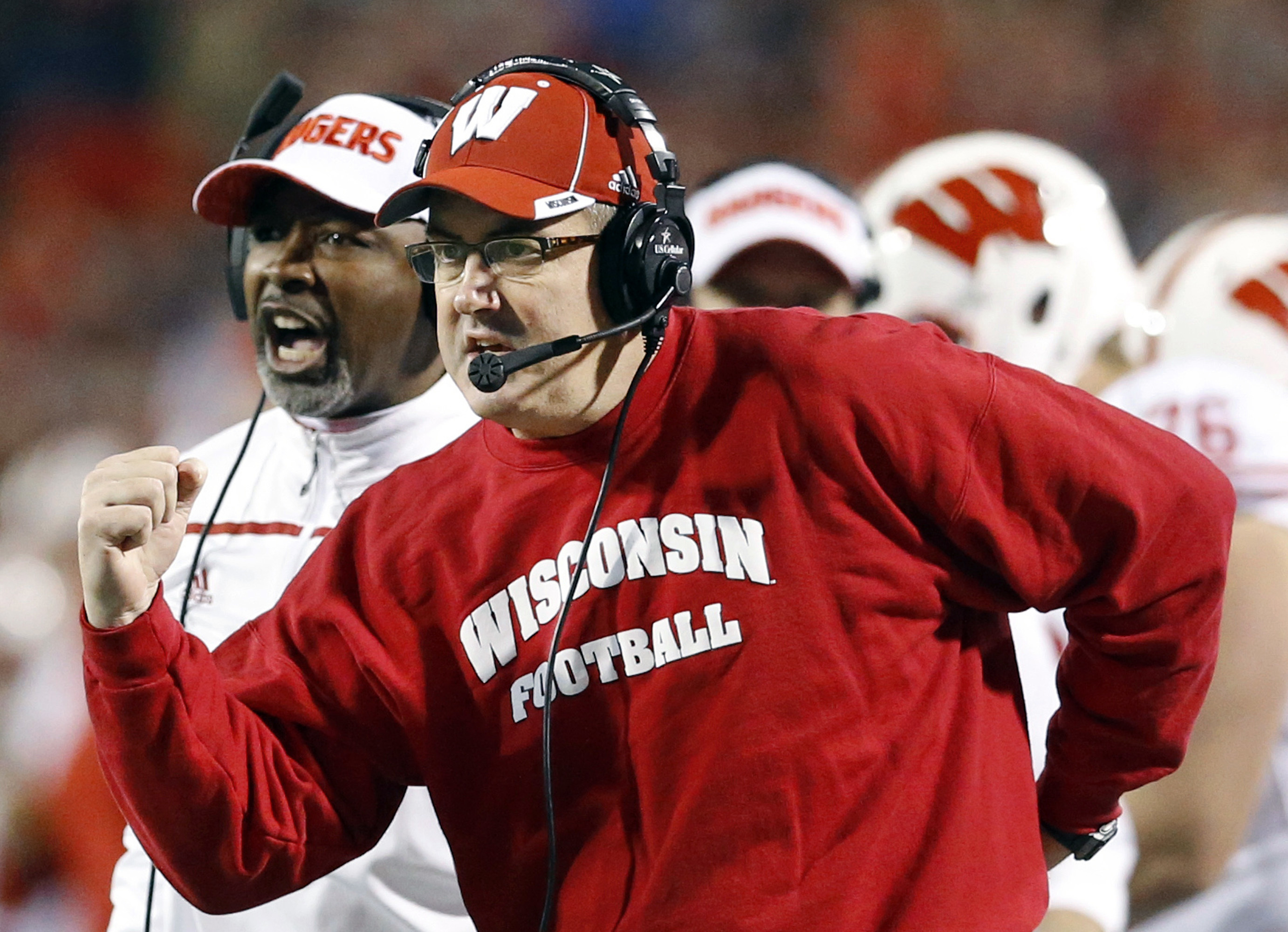 FILE - In this Nov. 7, 2015, file photo, Wisconsin head coach Paul Chryst, foreground, reacts after running back Alec Ingold scored a touchdown in the second half of an NCAA college football game against Maryland. Tenth-ranked Wisconsin plays its home ope