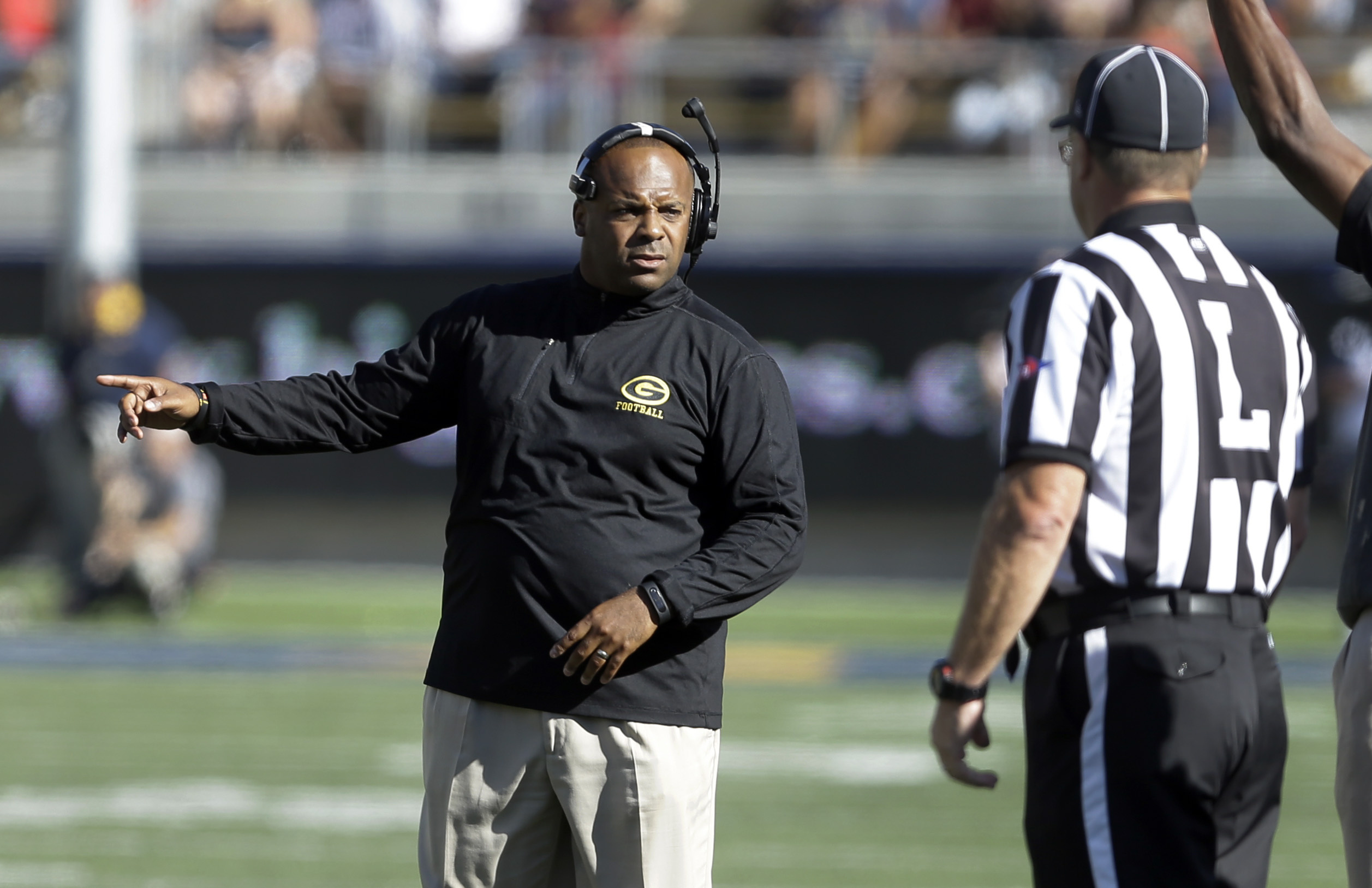 FILE - In this Sept. 5, 2015 file photo, Grambling State coach Broderick Fobbs, left, talks with an official during the second half of an NCAA college football game against Californiain Berkeley, Calif. Arizona host Grambling State on Saturday.  (AP Photo