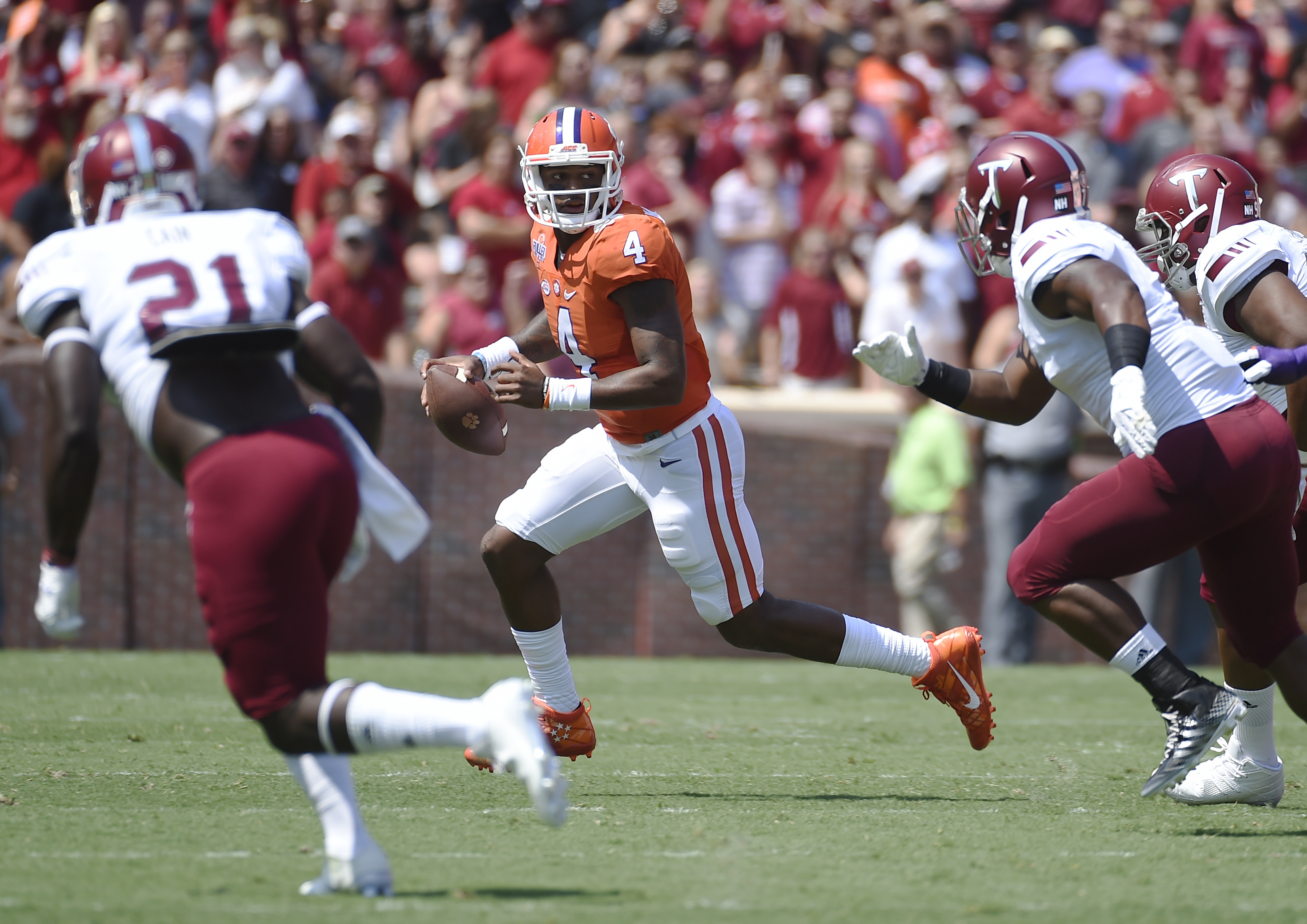 Clemson quarterback Deshaun Watson (4) scrambles as Troy players chase during the first half on an NCAA college football game on Saturday, Sept. 10, 2016, in Clemson, S.C. (AP Photo/Rainier Ehrhardt)