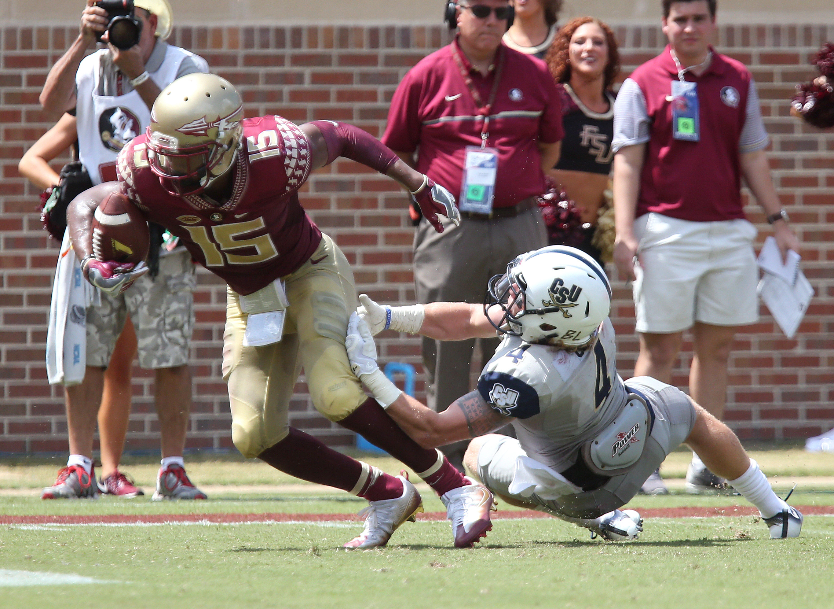 Florida State's Travis Rudolph escapes the tackle attempt of Charleston Southern's D.J. Curl to score his second touchdown in the first half of an NCAA college football game, Saturday, Sept. 10, 2016, in Tallahassee, Fla. (AP Photo/Steve Cannon)