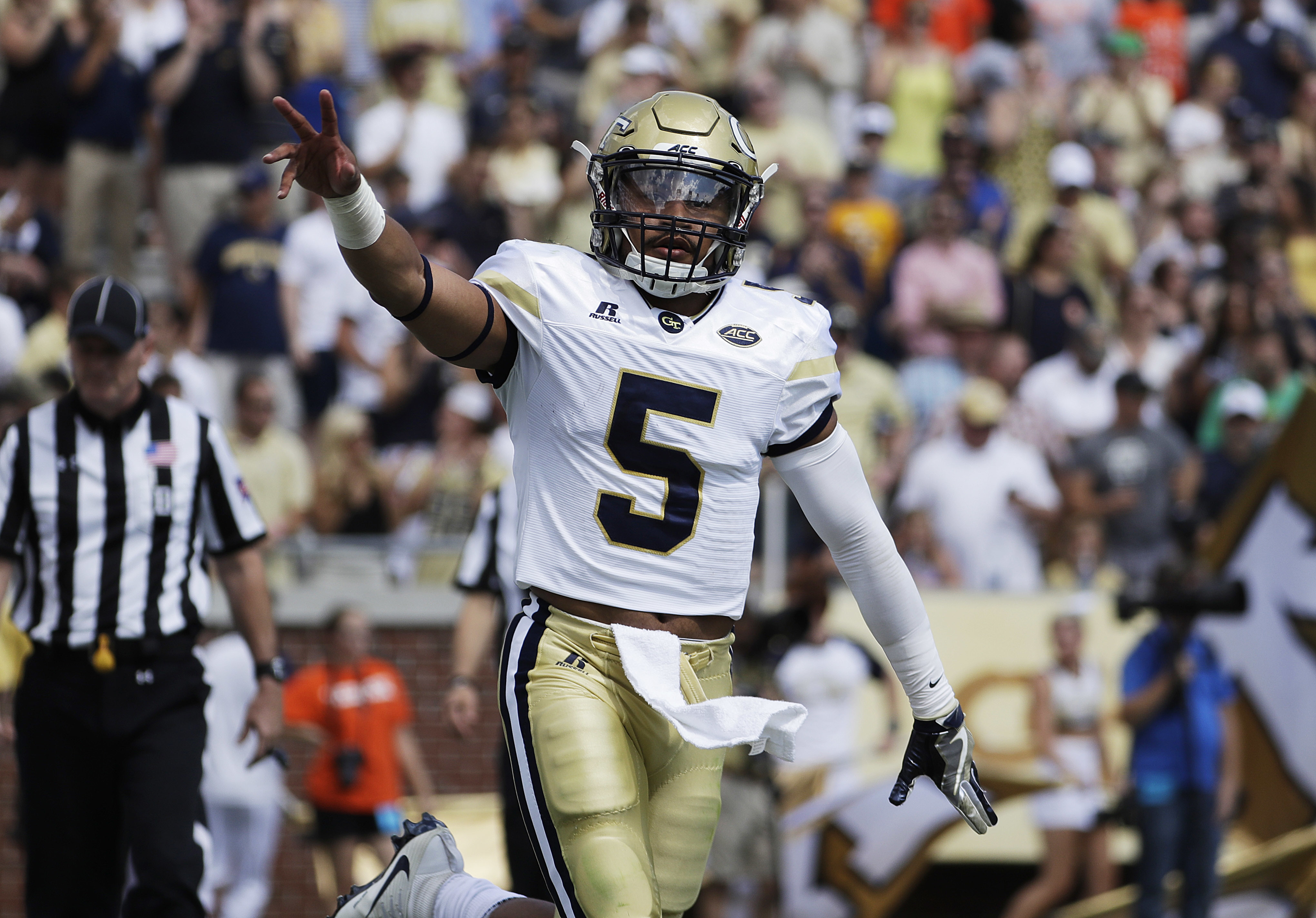 Georgia Tech quarterback Justin Thomas gestures to the crowd after running the ball for a touchdown in the first half of an NCAA college football game against Mercer in Atlanta, Saturday, Sept. 10, 2016. (AP Photo/David Goldman)