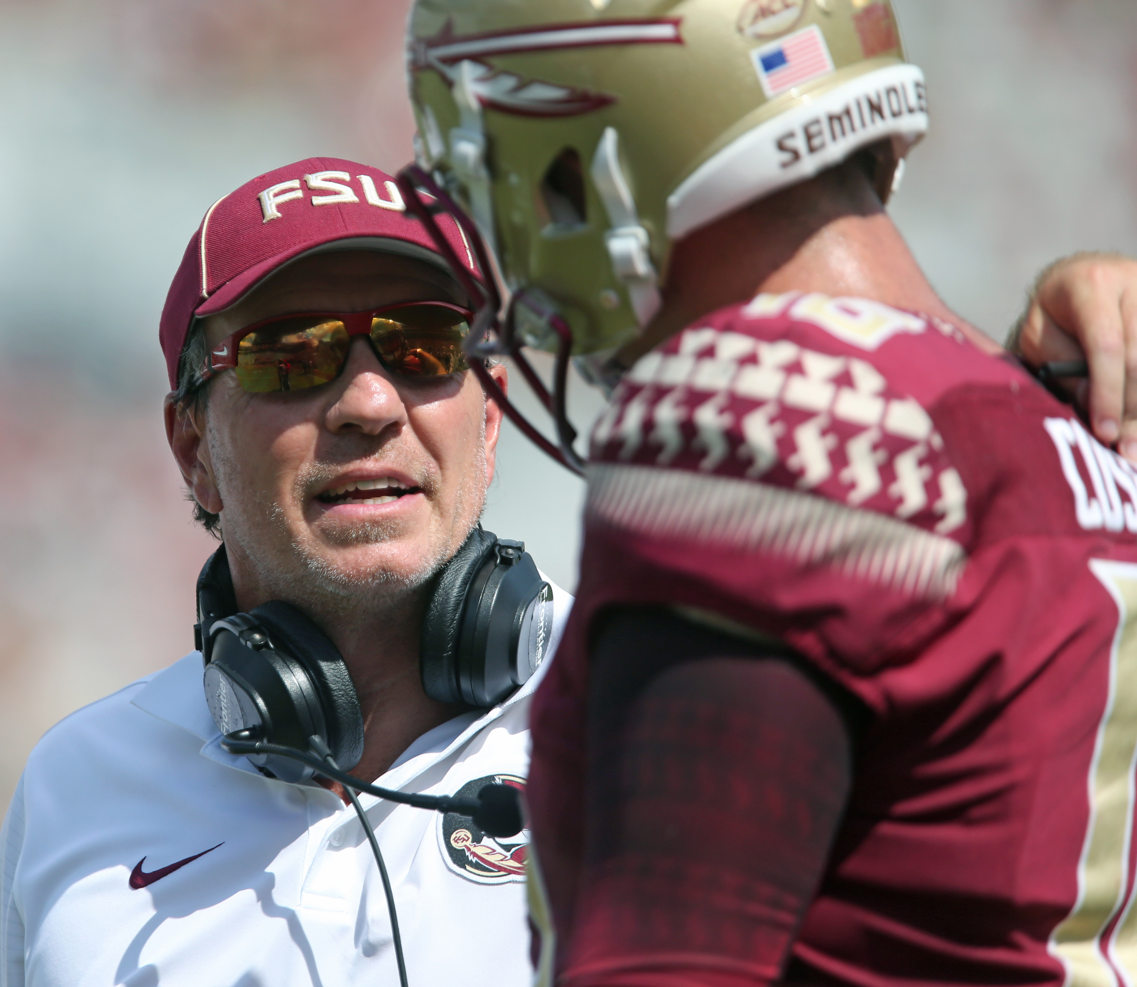 Florida State's head coach Jimbo Fisher talks with quarterback J.J. Cosentino during a time out while playing Charleston Southern in the second half of an NCAA college football game, Saturday, Sept. 10, 2016, in Tallahassee, Fla. Florida State won the gam