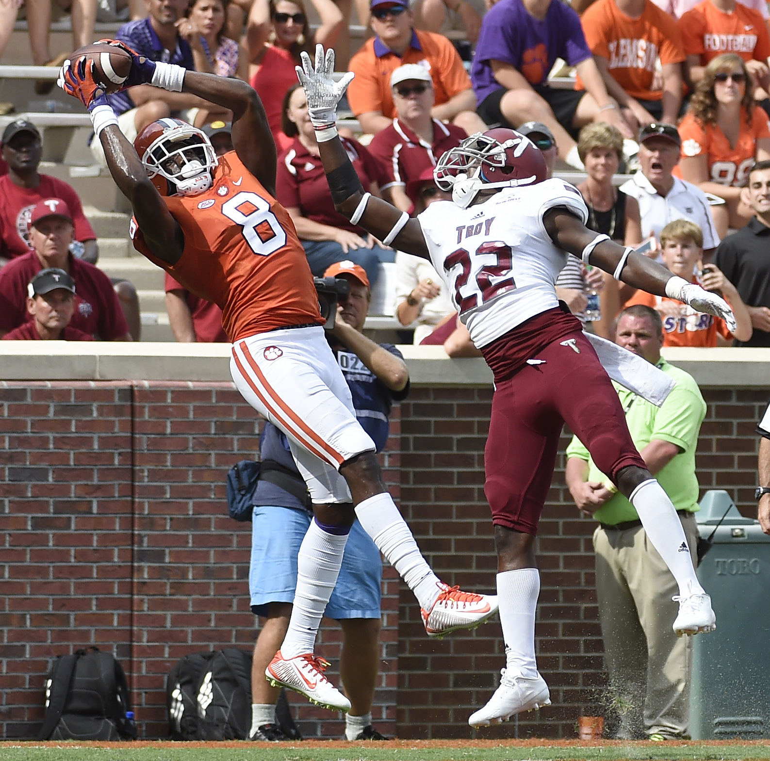 Clemson wide receiver Deon Cain (8) catches a touchdown pass in the end zone as Troy cornerback Jalen Rountree (22) defends during the second half an NCAA college football game on Saturday, Sept. 10, 2016, in Clemson, S.C. Clemson won 30-24. (AP Photo/Rai