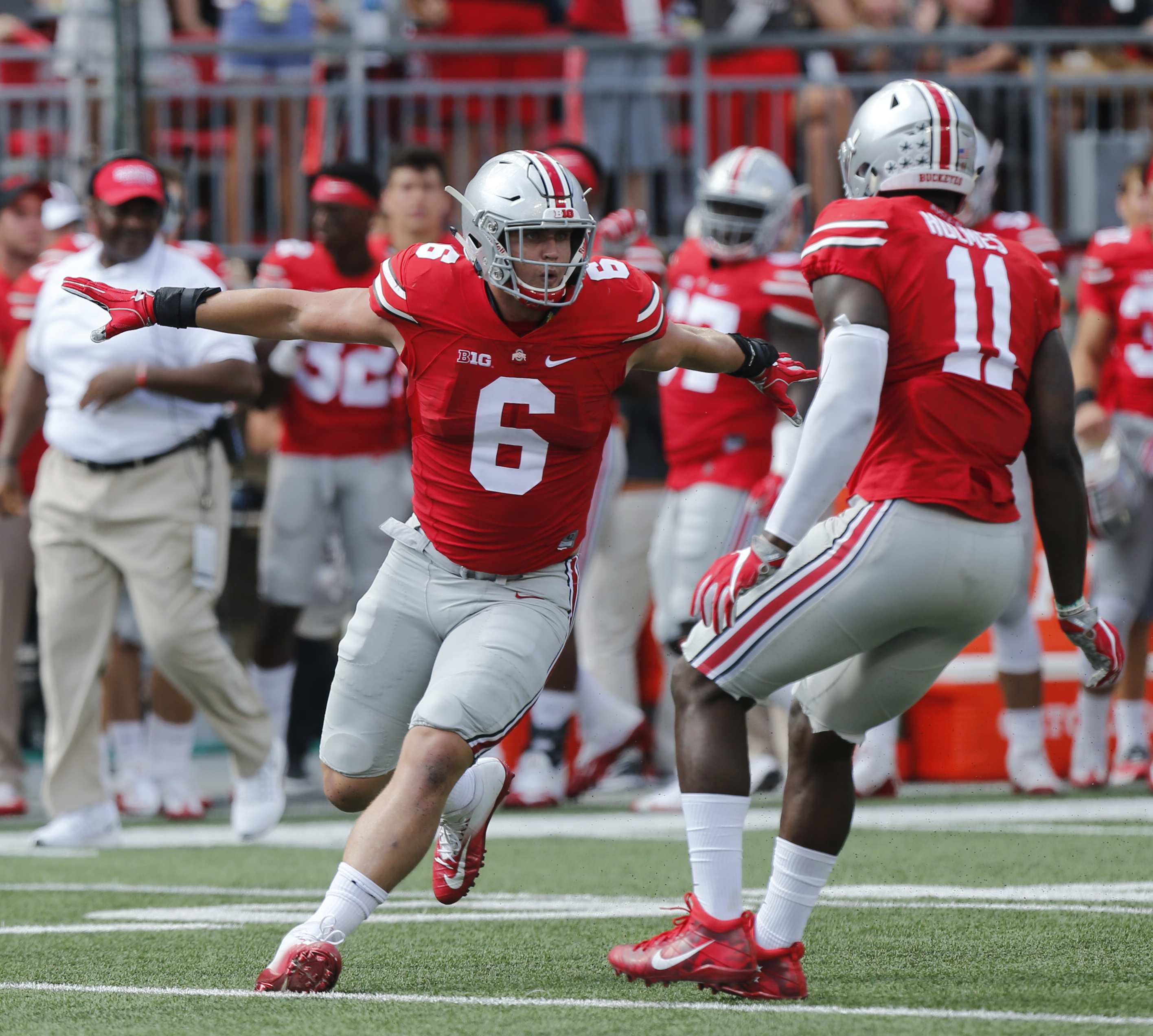 Ohio State defensive end Sam Hubbard, left, and defensive end Jalyn Holmes, celebrate their sack against Tulsa quarterback Dane Evans during the first half of an NCAA college football game, Saturday, Sept. 10, 2016, in Columbus, Ohio. (AP Photo/Jay LaPret