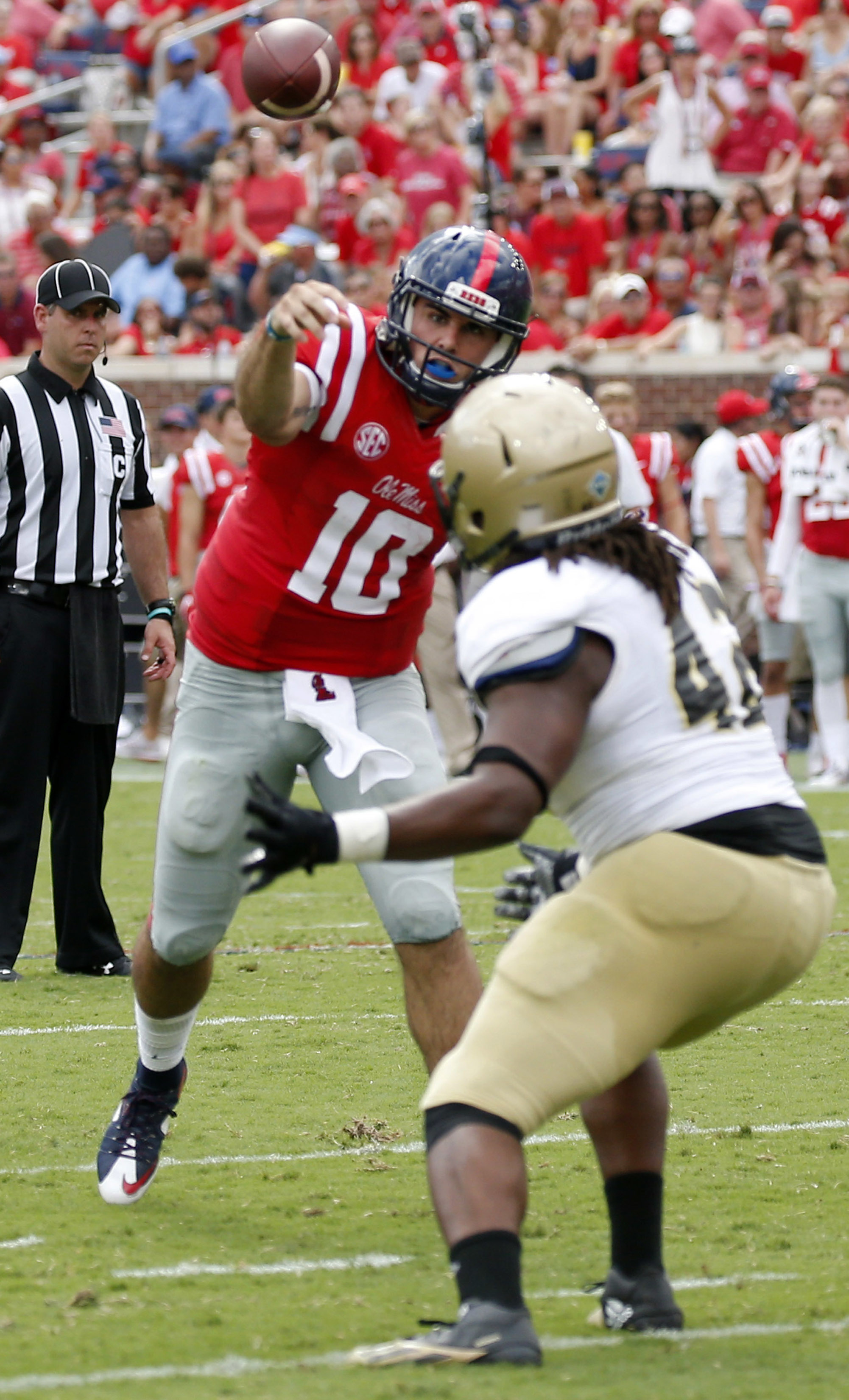 Mississippi quarterback Chad Kelly (10) throws a 6-yard touchdown pass to wide receiver Quincy Adeboyejo (8) in the first half of an NCAA college football game in Oxford, Miss., Saturday, Sept. 10, 2016. (AP Photo/Rogelio V. Solis)