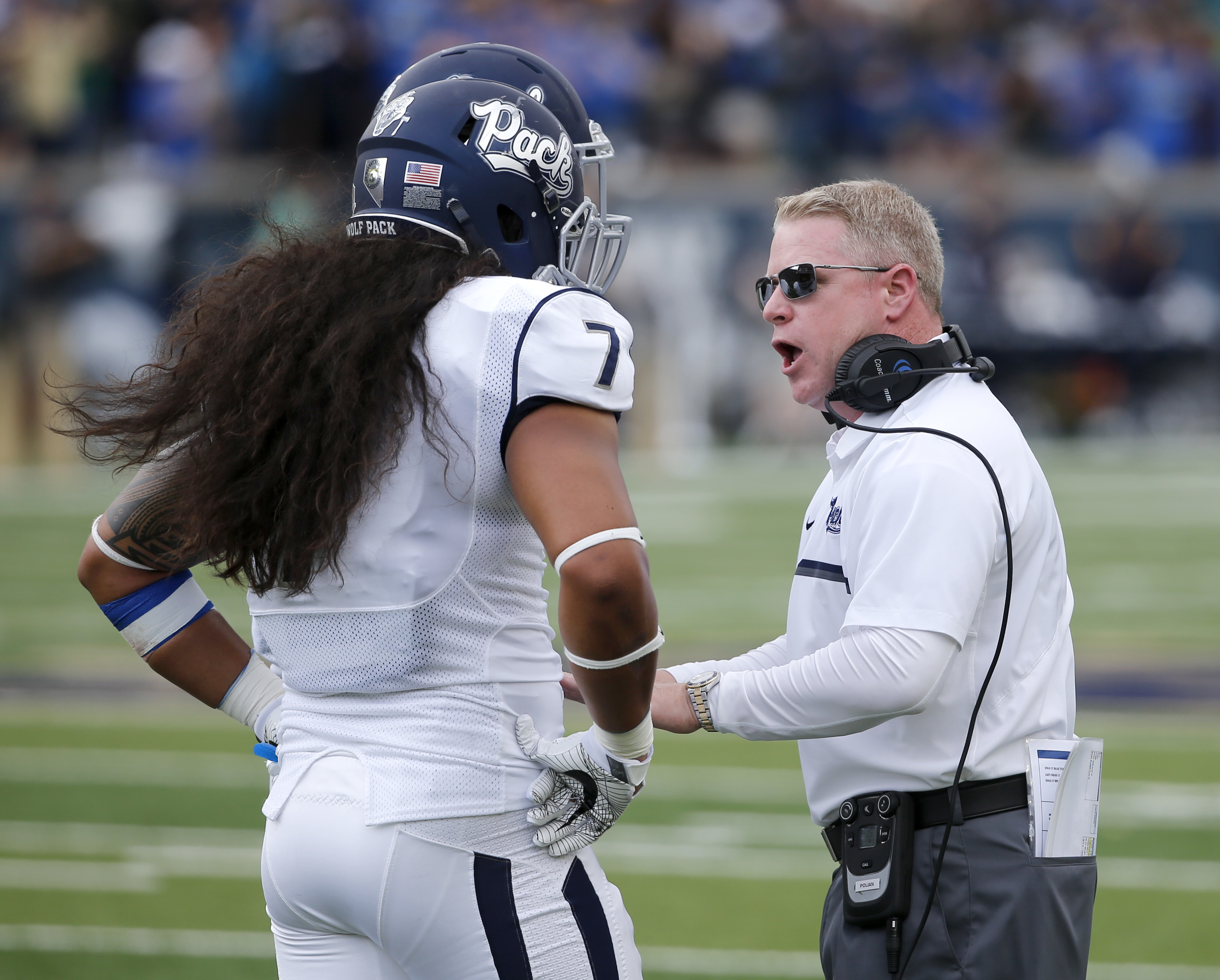 Nevada head coach Brian Polian, right, talks with Gabriel Sewell (7) during the first half of an NCAA college football game against Notre Dame, Saturday, Sept. 10, 2016, in South Bend, Ind. (AP Photo/Charles Rex Arbogast)