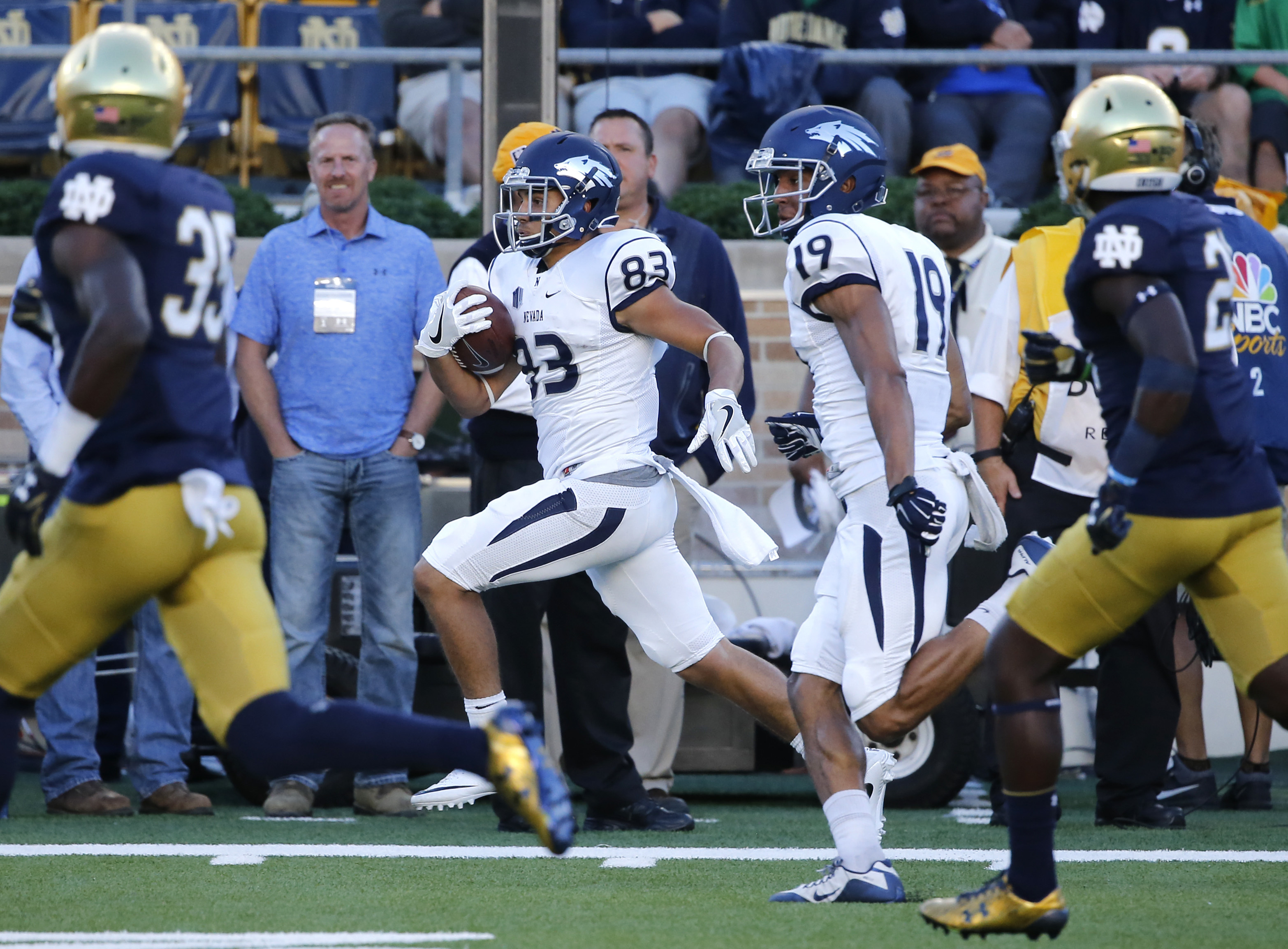Nevada wide receiver Andrew Celis (83) heads down the sidelines on a 68-yard pass play from Ty Gangi as teammate Wyatt Demps (19) follows during the second half of an NCAA college football game against Notre Dame Saturday, Sept. 10, 2016, in South Bend, I
