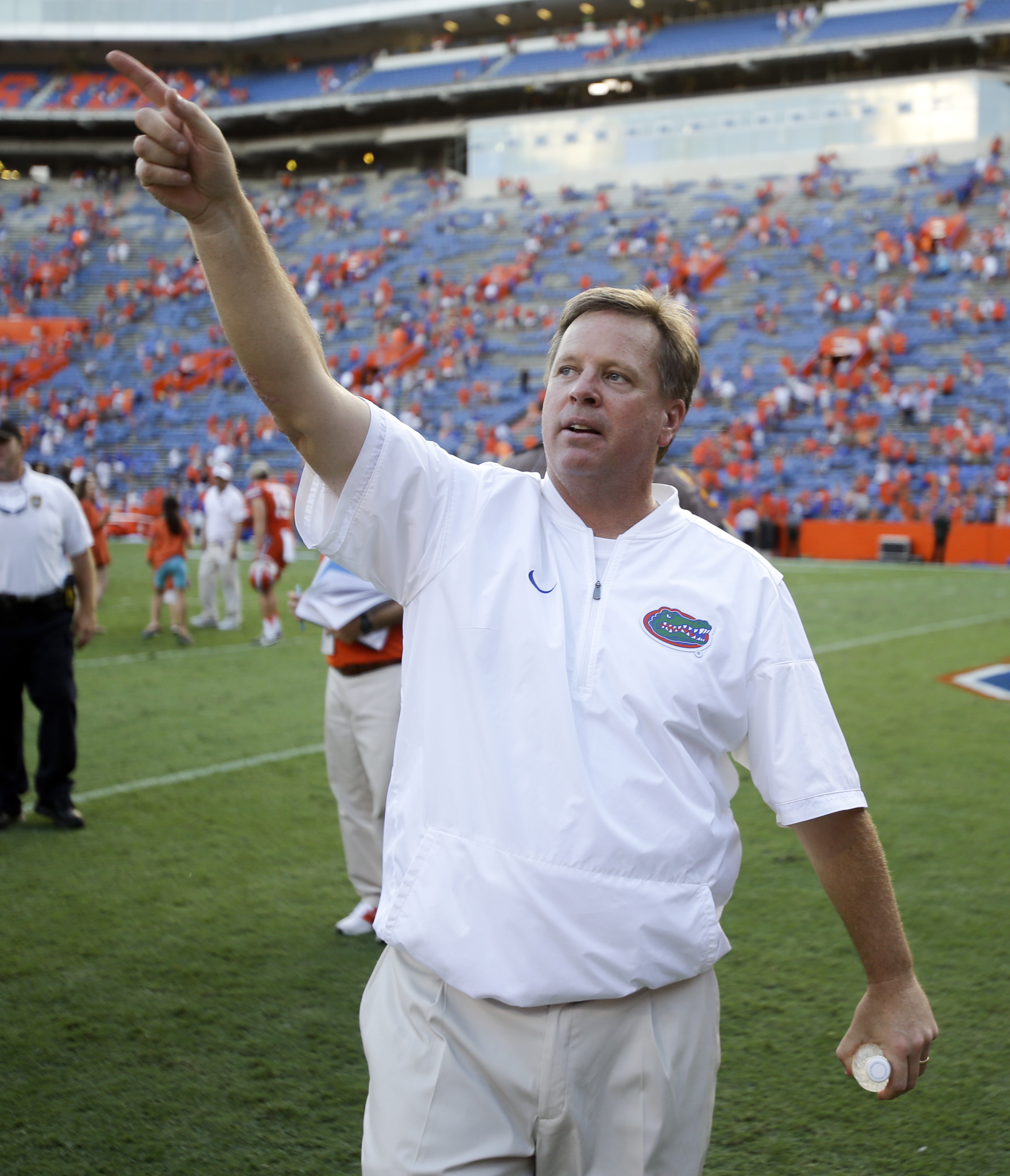 Florida head coach Jim McElwain points to fans as they cheer after Florida defeated Kentucky 45-7 in an NCAA college football game, Saturday, Sept. 10, 2016, in Gainesville, Fla. (AP Photo/John Raoux)