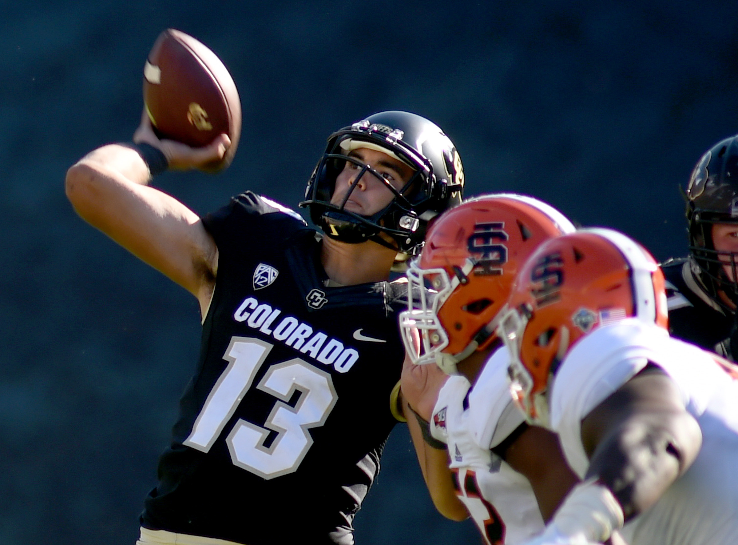 Colorado quarterback, Sefo Liufau, throws down field during the first half of an NCAA college football game against Idaho State, Saturday, Sept. 10, 2016 in Boulder, Colo. (Cliff Grassmick/The Daily Camera via AP)