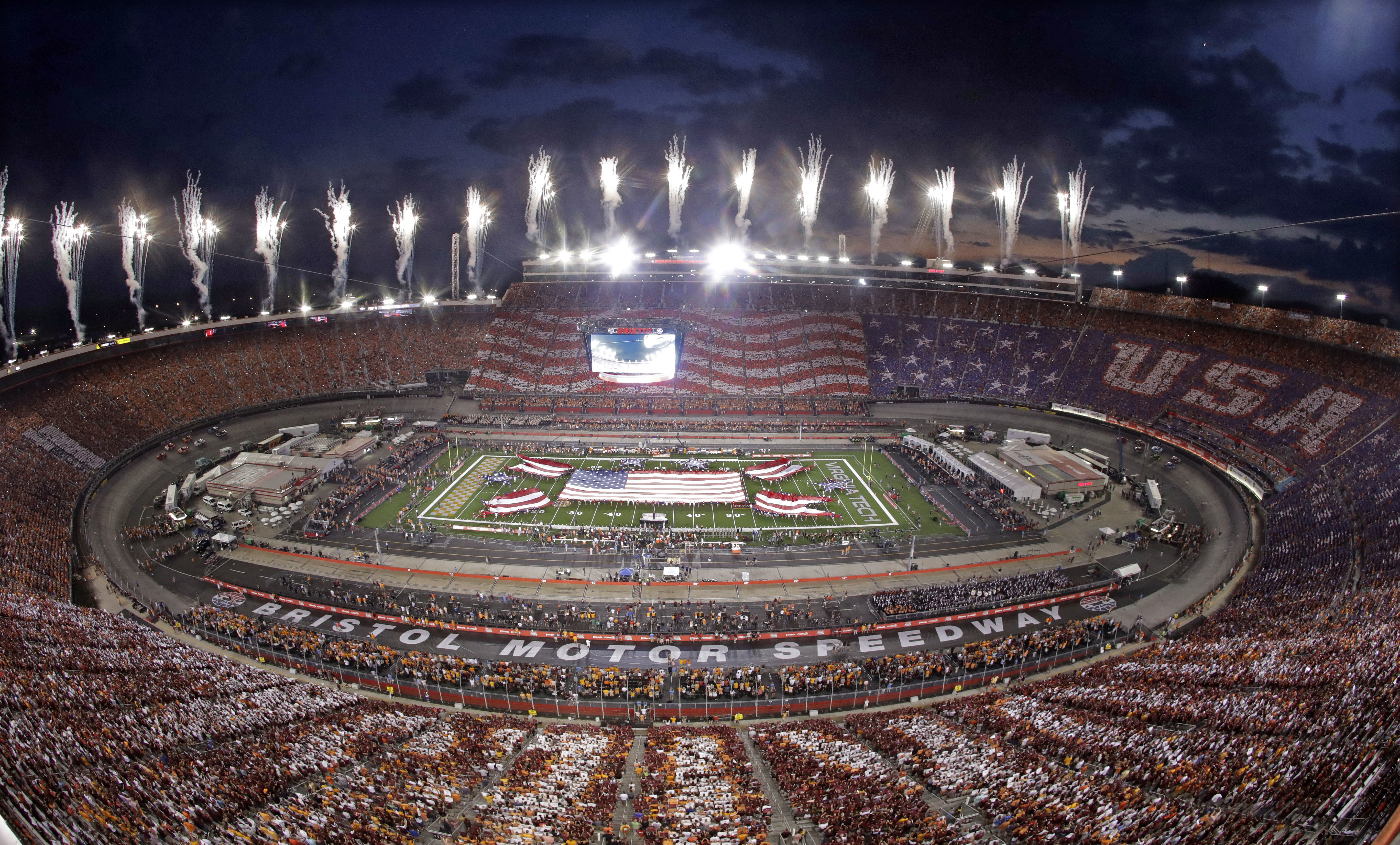 Flags are displayed and fireworks are set off during the national anthem before an NCAA college football game between Tennessee and Virginia Tech at Bristol Motor Speedway on Saturday, Sept. 10, 2016, in Bristol, Tenn. (AP Photo/Mark Humphrey)