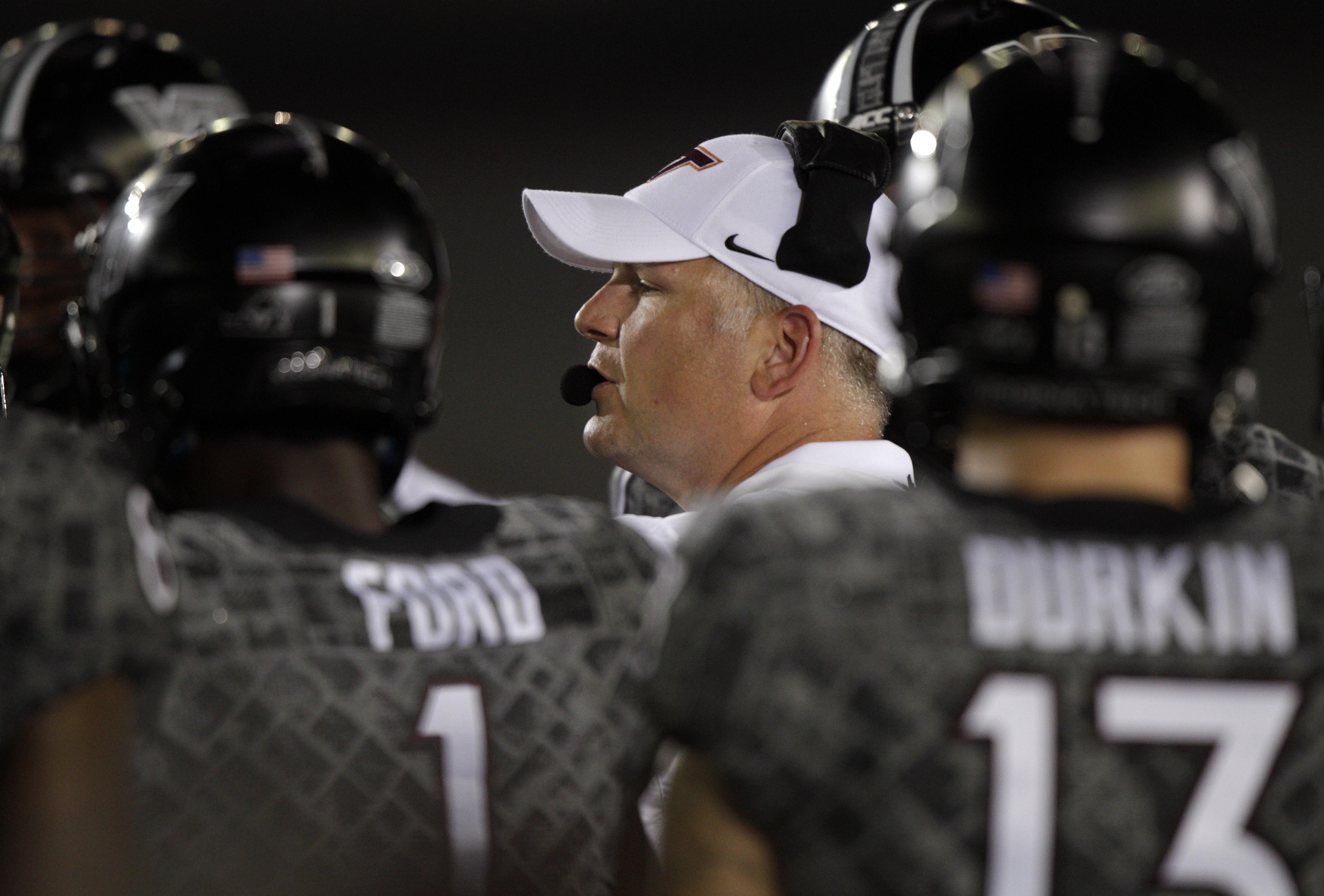 Virginia Tech coach Justin Fuente talks with his players during the first half of an NCAA college football game against Tennessee at Bristol Motor Speedway on Saturday, Sept. 10, 2016, in Bristol, Tenn. (AP Photo/Wade Payne)