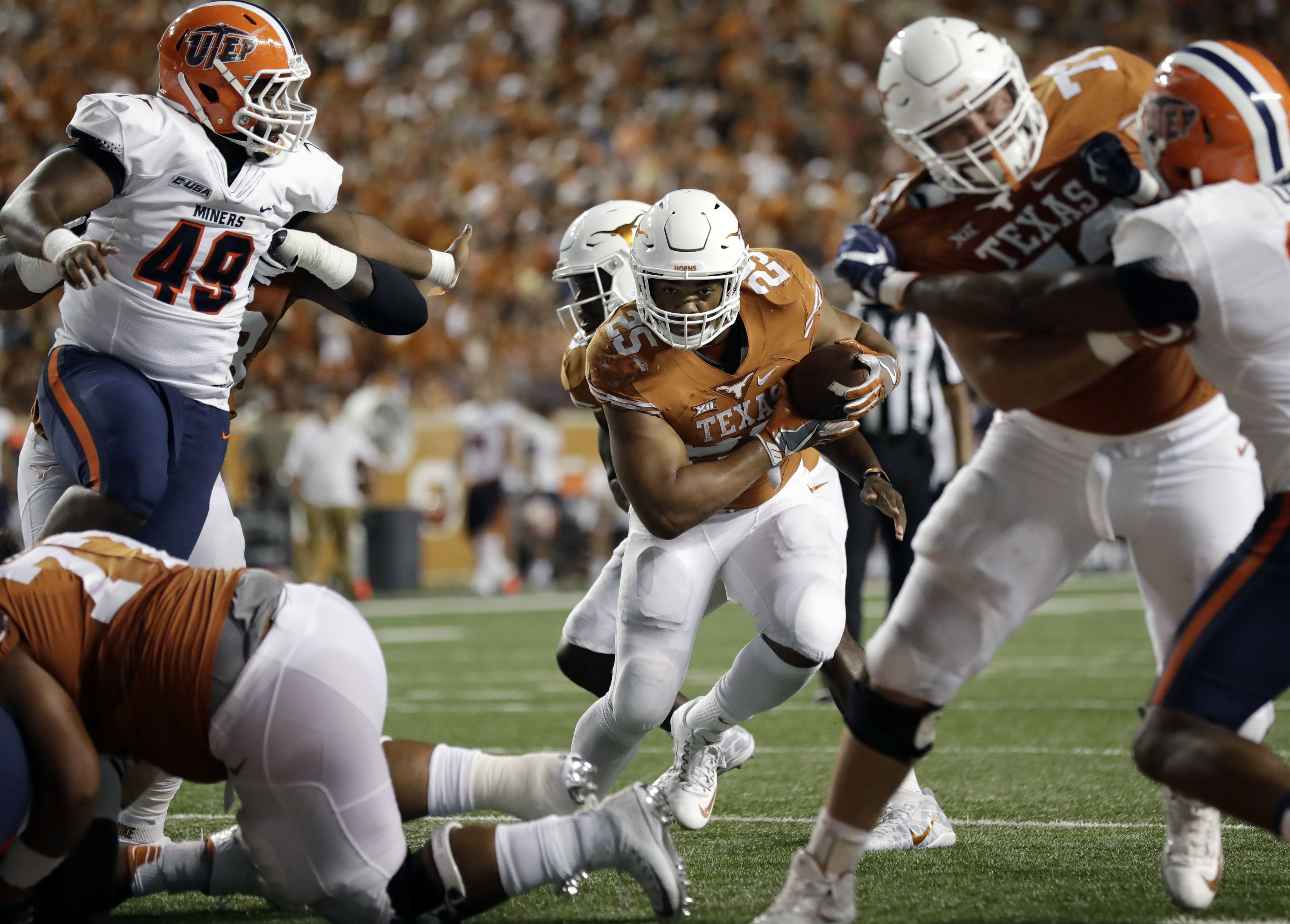 Texas running back Chris Warren III (25) rushes for a touchdown against UTEP during the second half of a NCAA college football game, Saturday, Sept. 10, 2016, in Austin. (AP Photo/Eric Gay)