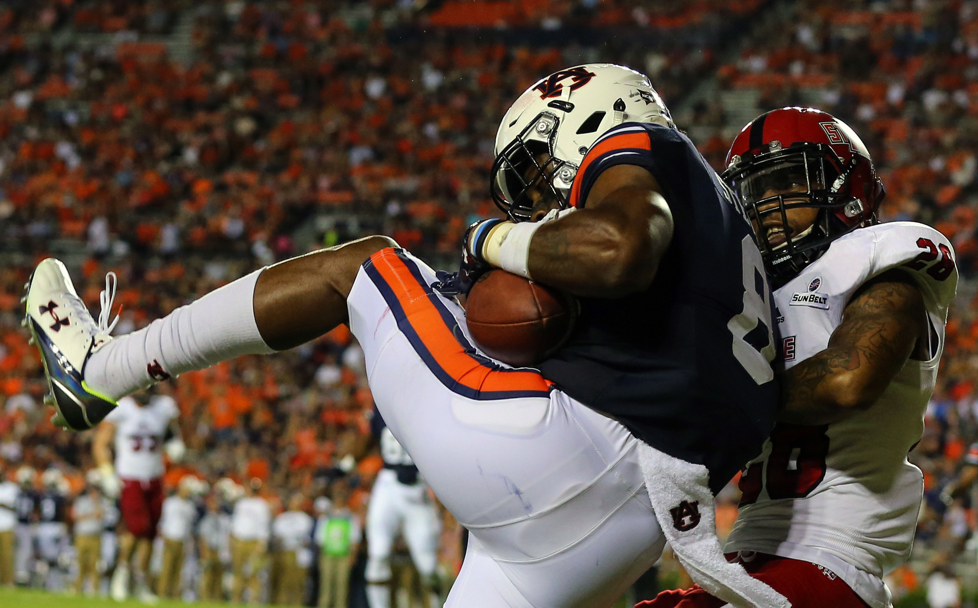 Auburn wide receiver Tony Stevens (8) catches a pass for a touchdown over Arkansas State defensive back Brandon Byner, right, during the second half of an NCAA college football game, Saturday, Sept. 10, 2016, in Auburn, Ala. (AP Photo/Butch Dill)