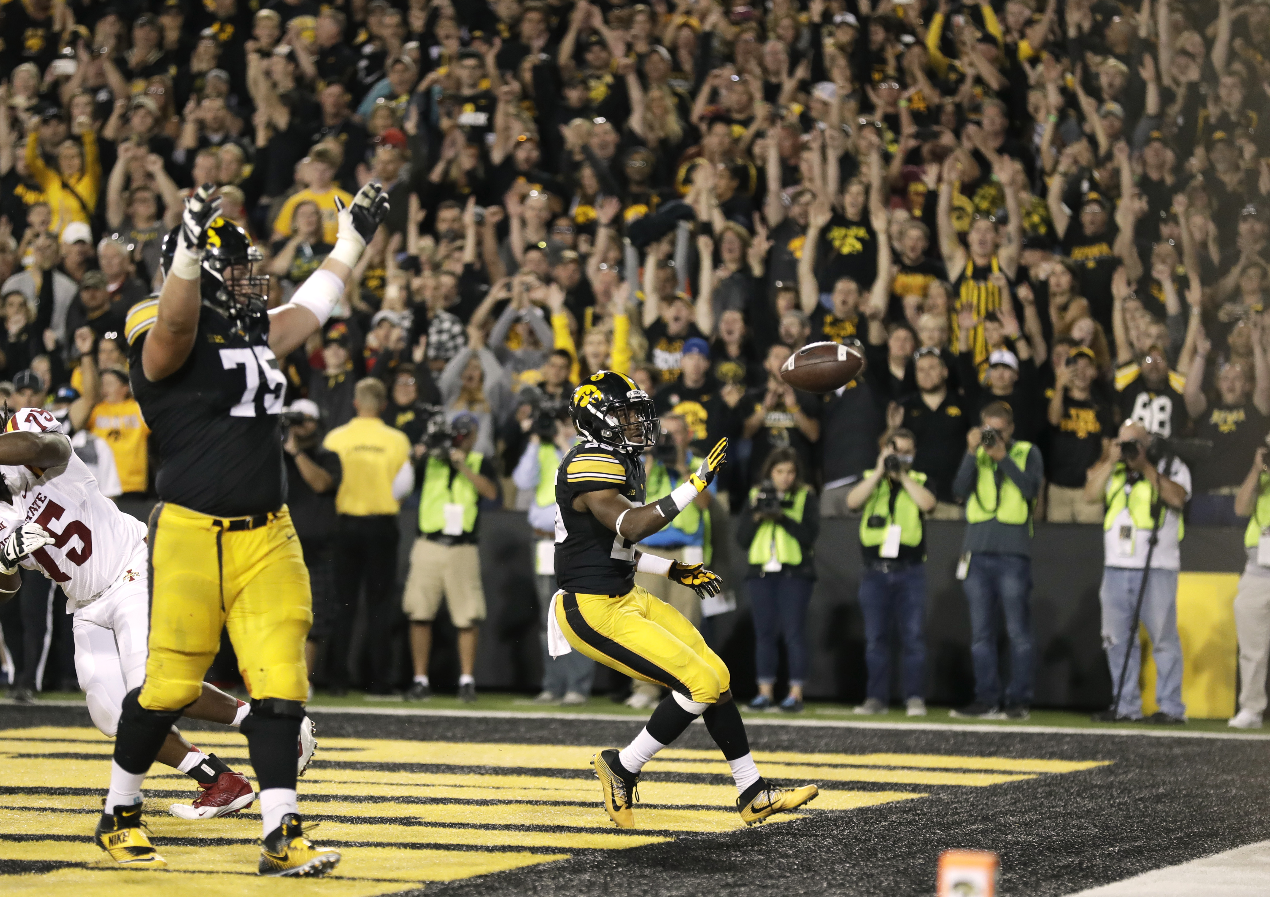 Iowa running back Akrum Wadley celebrates in the end zone with teammate Ike Boettger, left, after scoring on a 3-yard touchdown run during the second half of an NCAA college football game against Iowa State, Saturday, Sept. 10, 2016, in Iowa City, Iowa. I