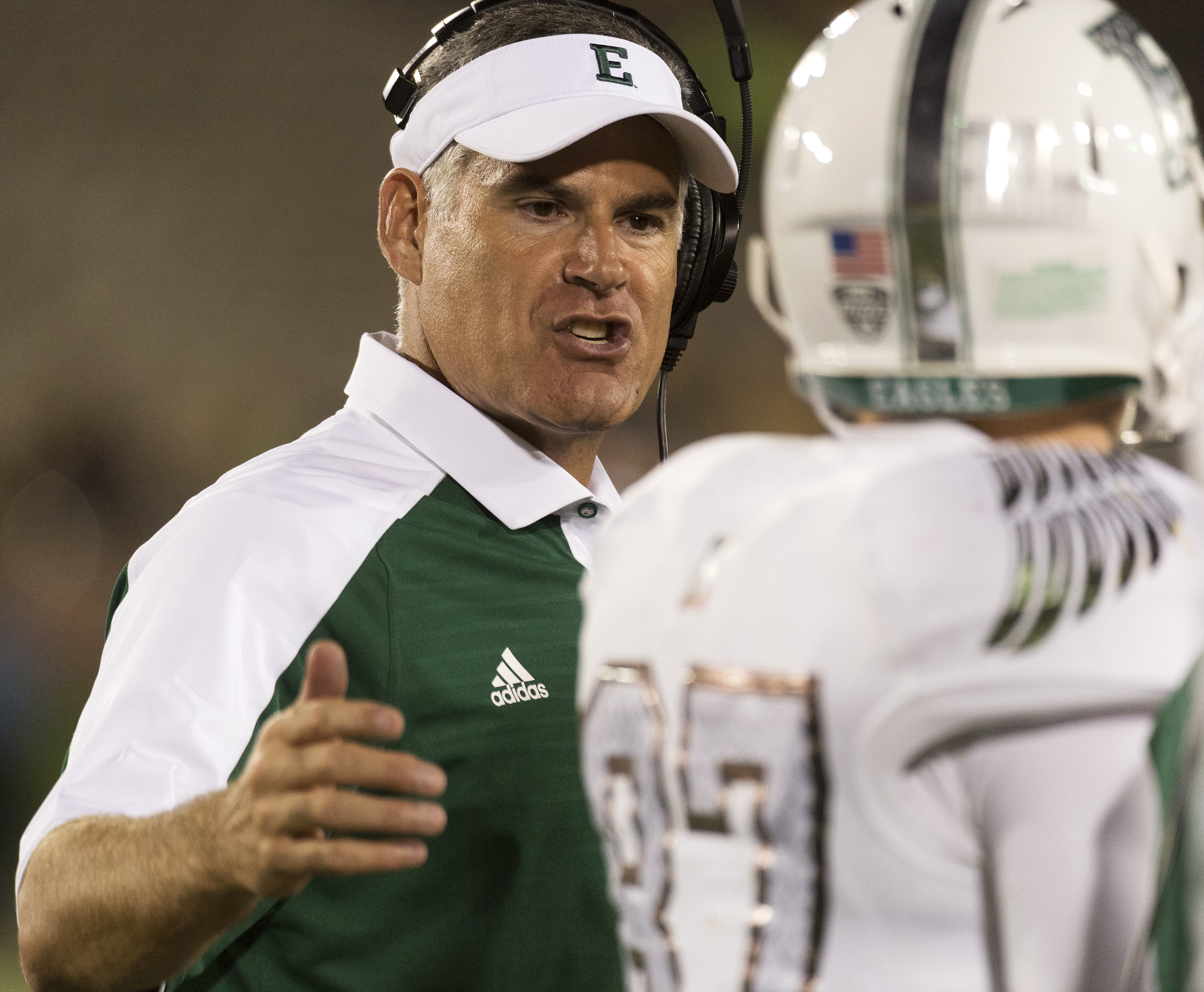 Eastern Michigan head coach Chris Creighton, left, talks to wide receiver Mathew Sexton during the third quarter of an NCAA college football game against Missouri Saturday, Sept. 10, 2016, in Columbia, Mo. (AP Photo/L.G. Patterson)