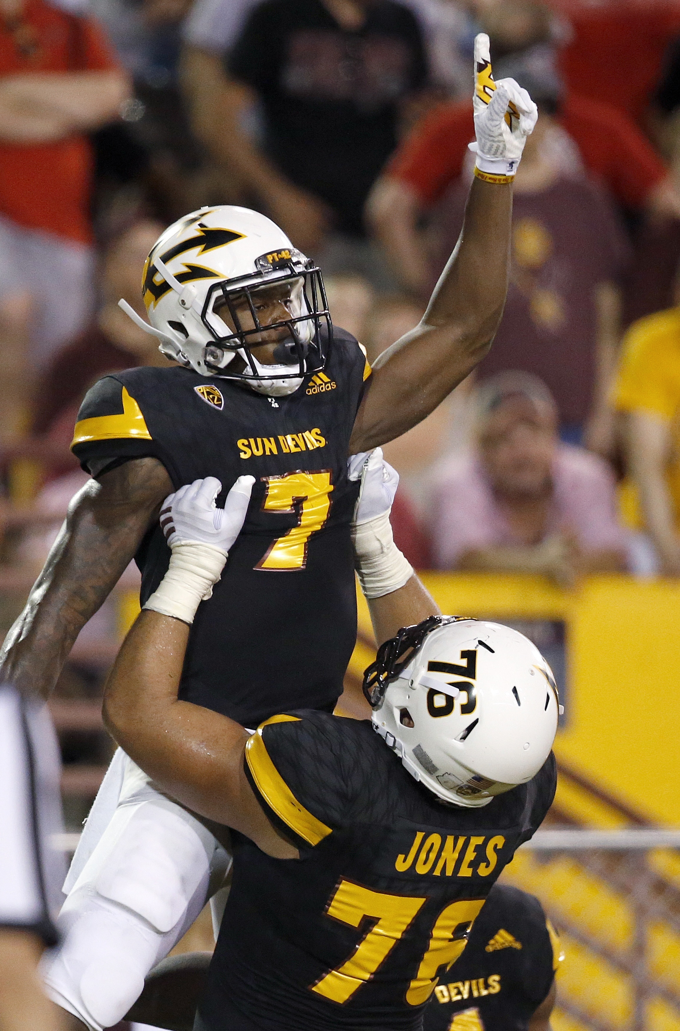 Arizona State's Kalen Ballage (7) celebrates a touchdown against Texas Tech with Sam Jones, right, during the first half of an NCAA college football game Saturday, Sept. 10, 2016, in Tempe, Ariz. (AP Photo/Ross D. Franklin)