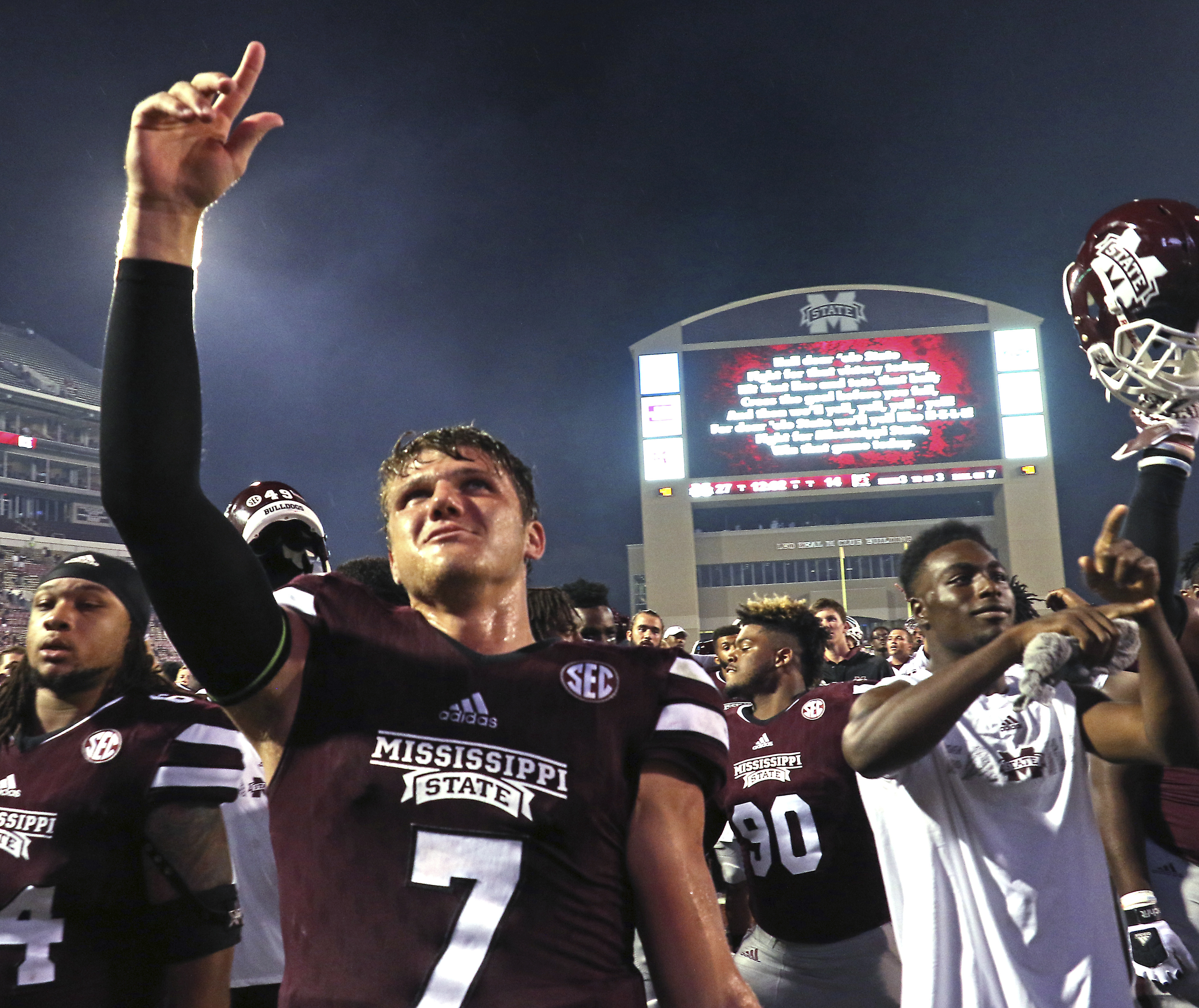 Mississippi State quarterback Nick Fitzgerald (7) celebrate his team's 27-14 win over South Carolina in an NCAA college football game in Starkville, Miss., Saturday, Sept. 10, 2016. (AP Photo/Jim Lytle)