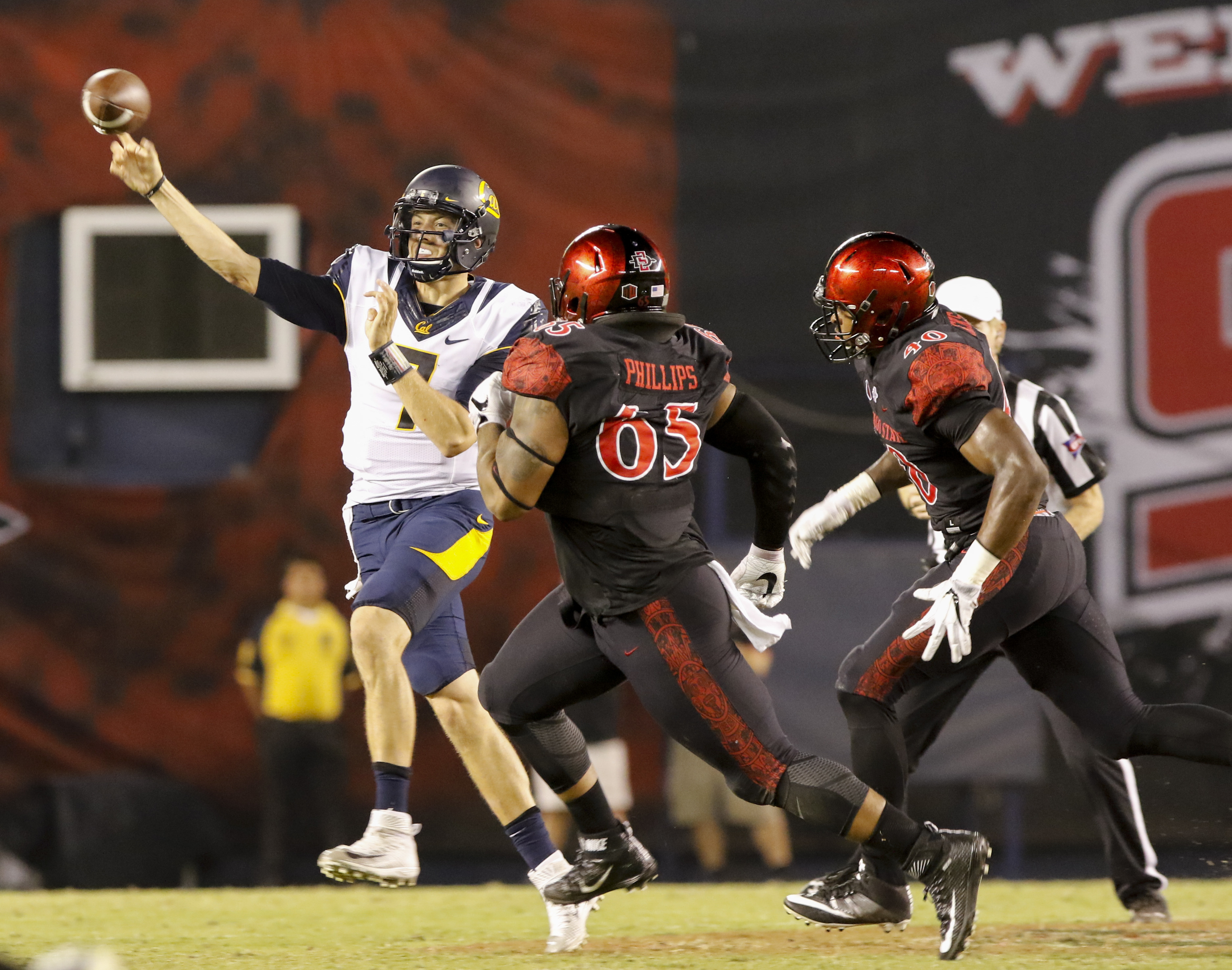 California quarterback Davis Webb throws to wide receiver Chad Hansen despite the pressure from San Diego State's Sergio Phillips, center, and Randy Ricks during the first half of an NCAA college football game Saturday, Sept. 10, 2016, in San Diego. (AP P