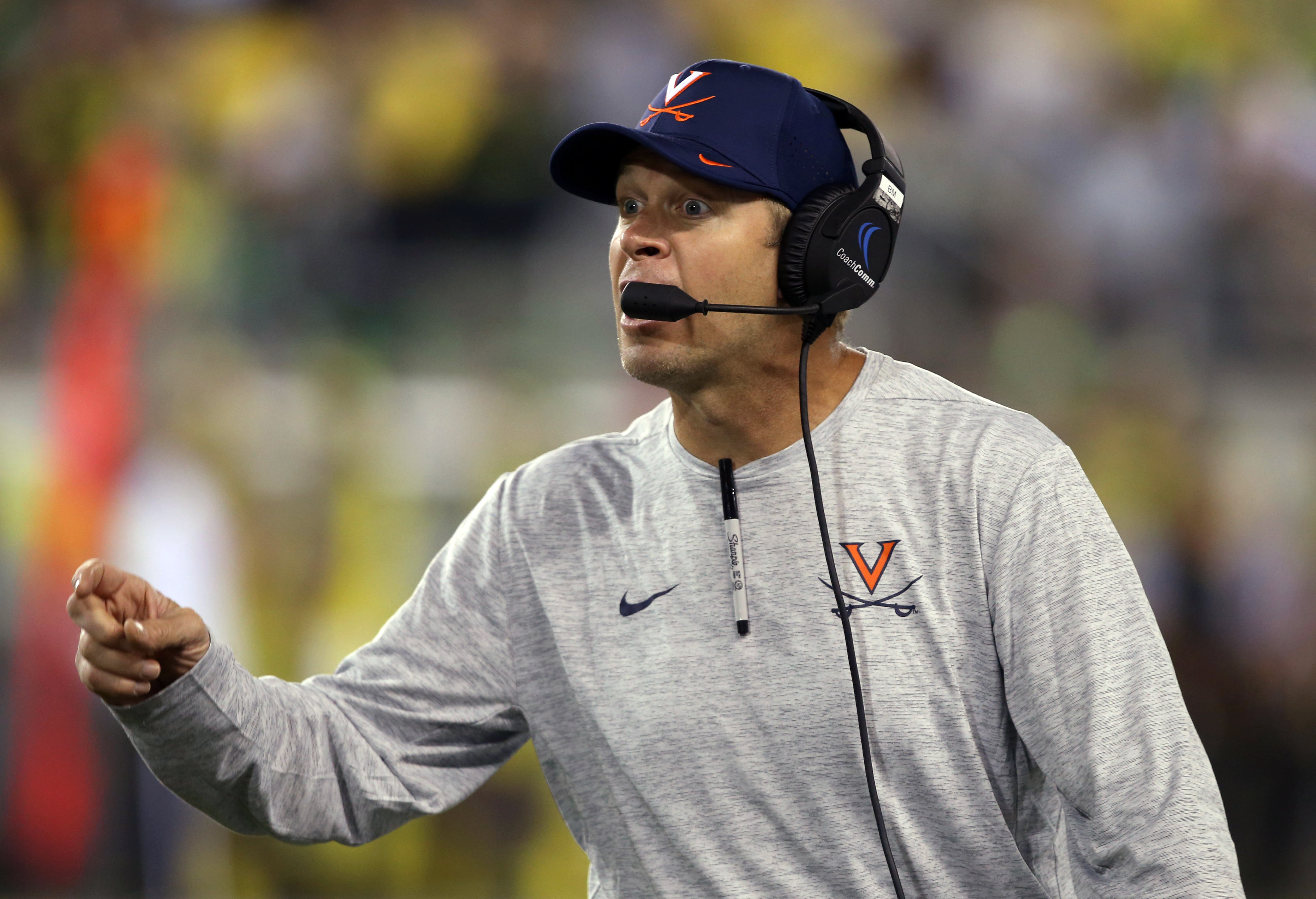 Virginia Head Football Coach Bronco Mendenhall calls to his team during the second half  of an NCAA college football game against Oregon Saturday, Sept. 10, 2016 in Eugene, Ore. (AP Photo/Chris Pietsch)