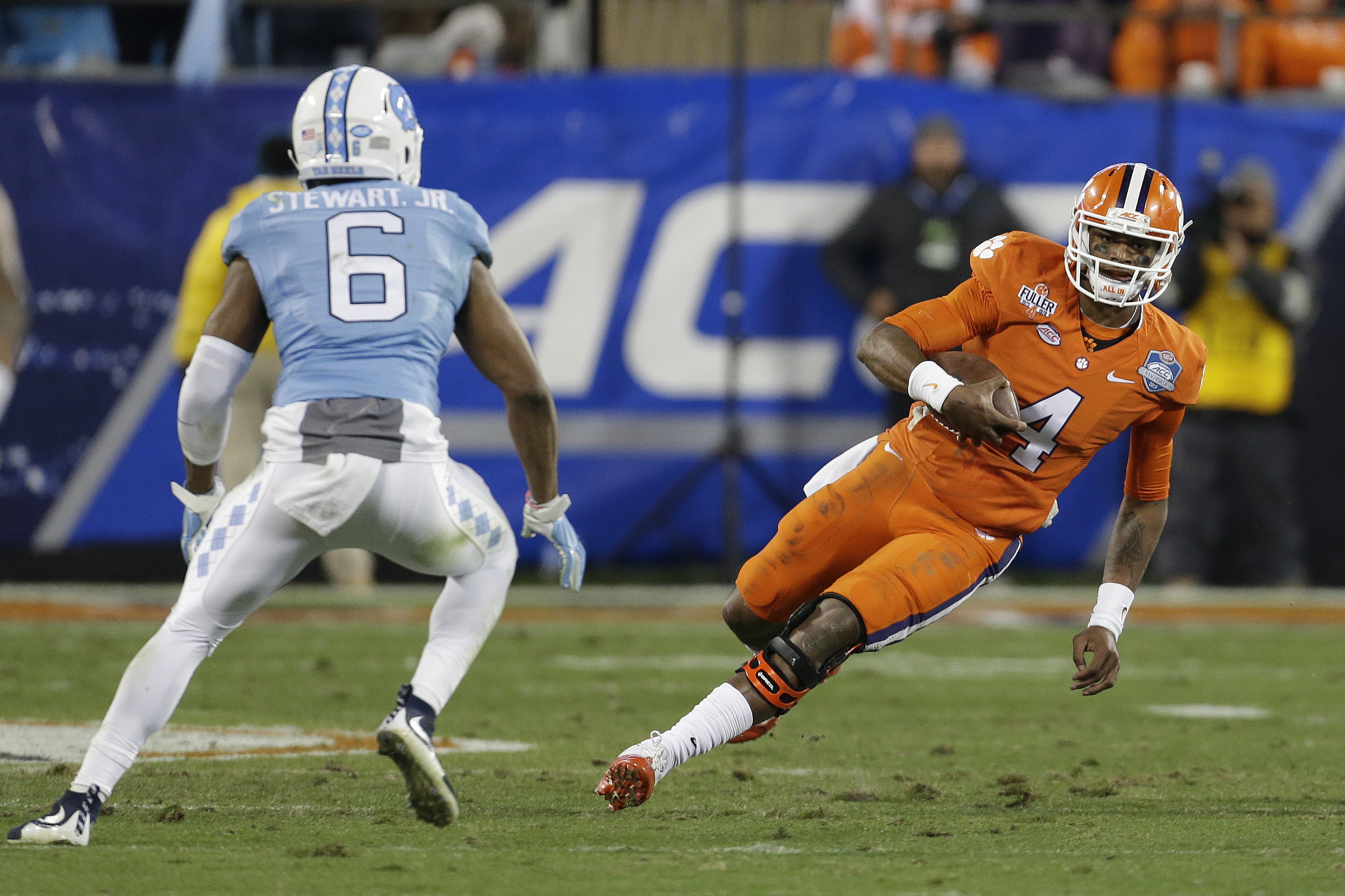 *FILE - In this Saturday, Dec. 5, 2015 file photo, Clemson quarterback Deshaun Watson (4) runs the ball as North Carolina's M.J. Stewart (6) moves in for the tackle during the first half of the Atlantic Coast Conference championship NCAA college football