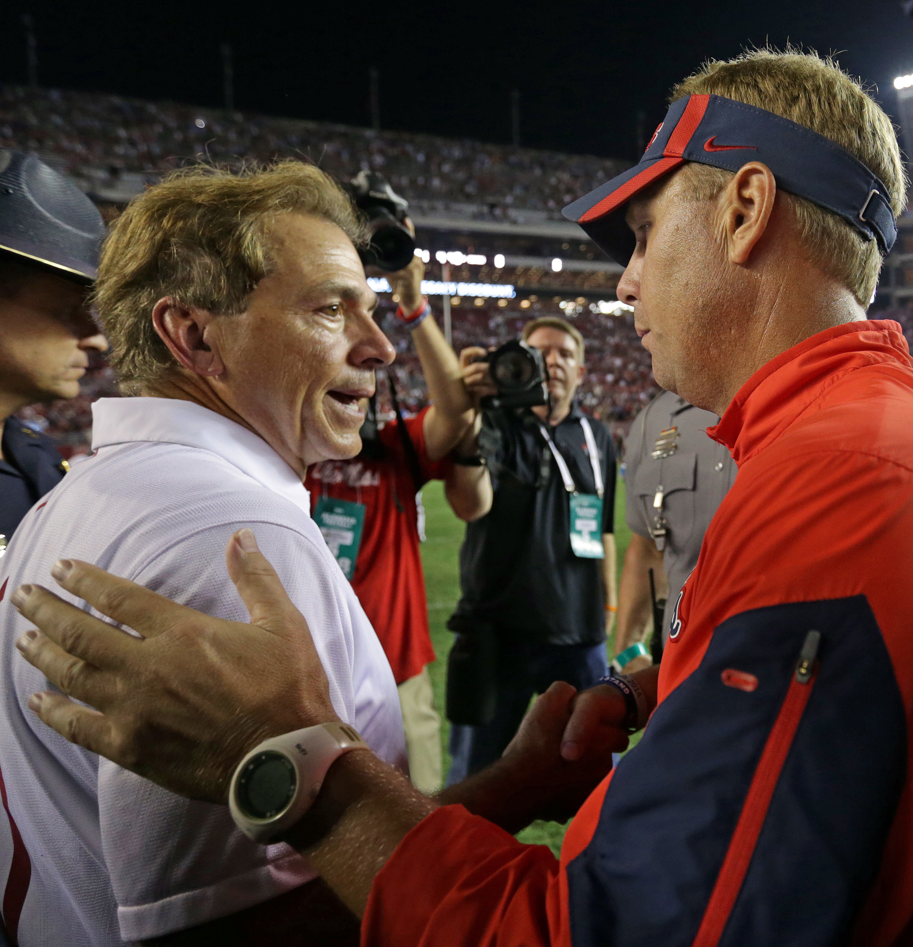 FILE - In this Sept. 20, 2015, file photo, Alabama head coach Nick Saban, left, talks with Mississippi head coach Hugh Freeze, right, after Ole Miss won  43-37 in an NCAA college football game in Tuscaloosa, Ala. There are six undefeated teams in the Sout