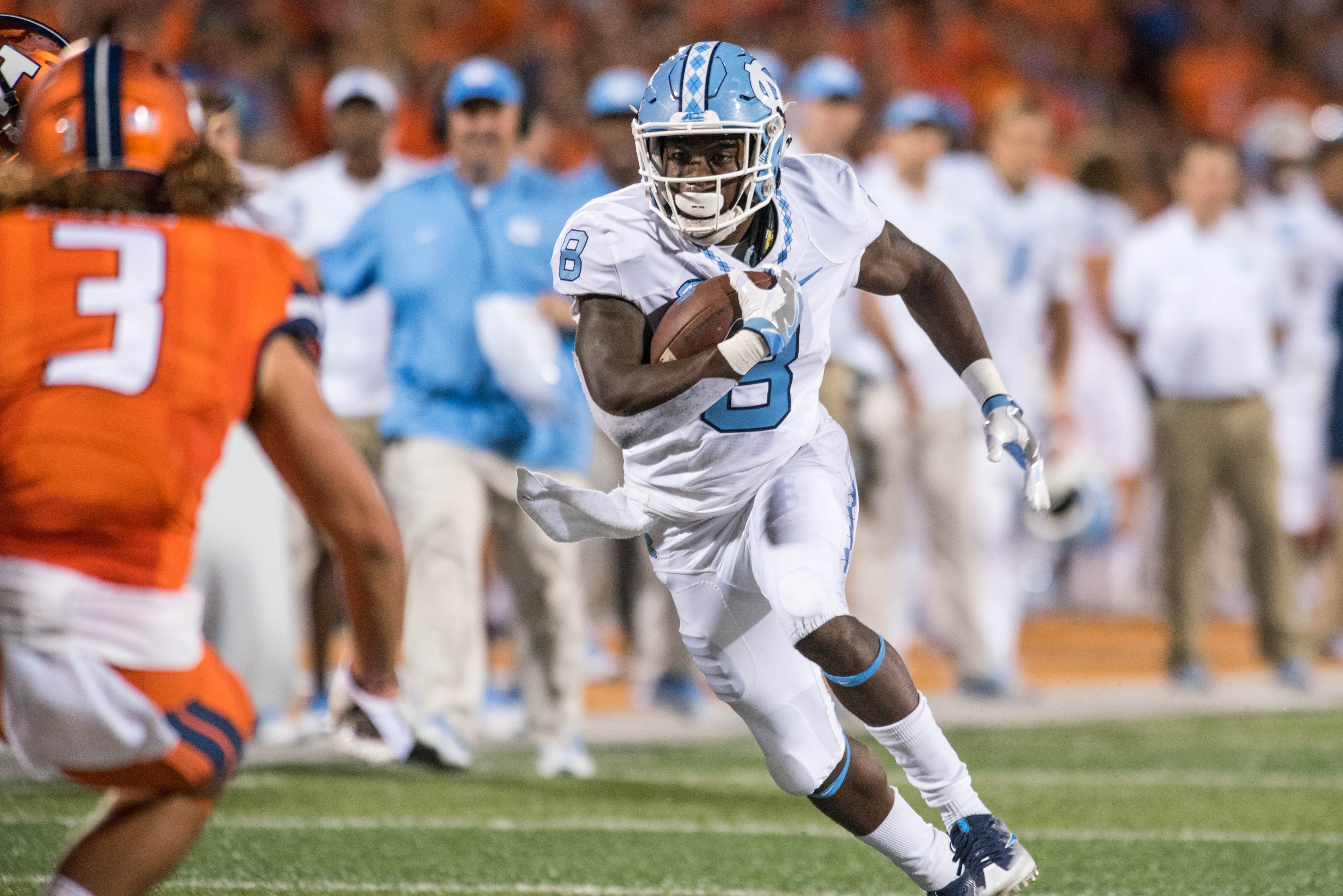 FILE - In this Sept. 10, 2016, file photo, North Carolina running back T.J. Logan (8) runs the ball during an NCAA college football game against Illinois, in Champaign, Ill. Logan has come up with big runs and long kick returns to start his senior year. A
