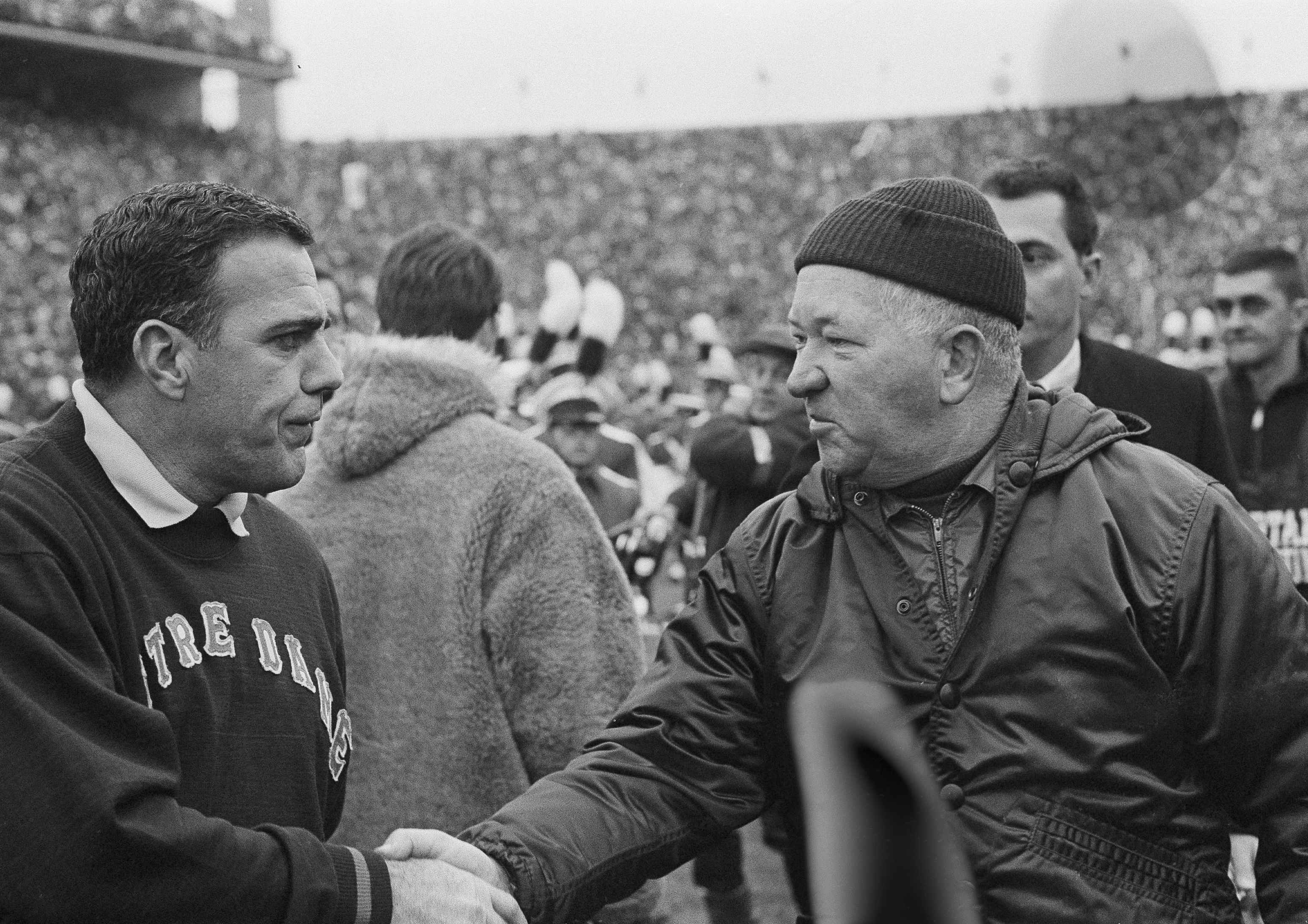 FILE - In this Nov. 19, 1966, file photo, Notre Dame football coach Ara Parseghian, left, shakes hands with Michigan State coach Duffy Daugherty after their 10-10 tie in East Lansing, Mich. Parseghian still bristles 50 years later at the notion that No. 1