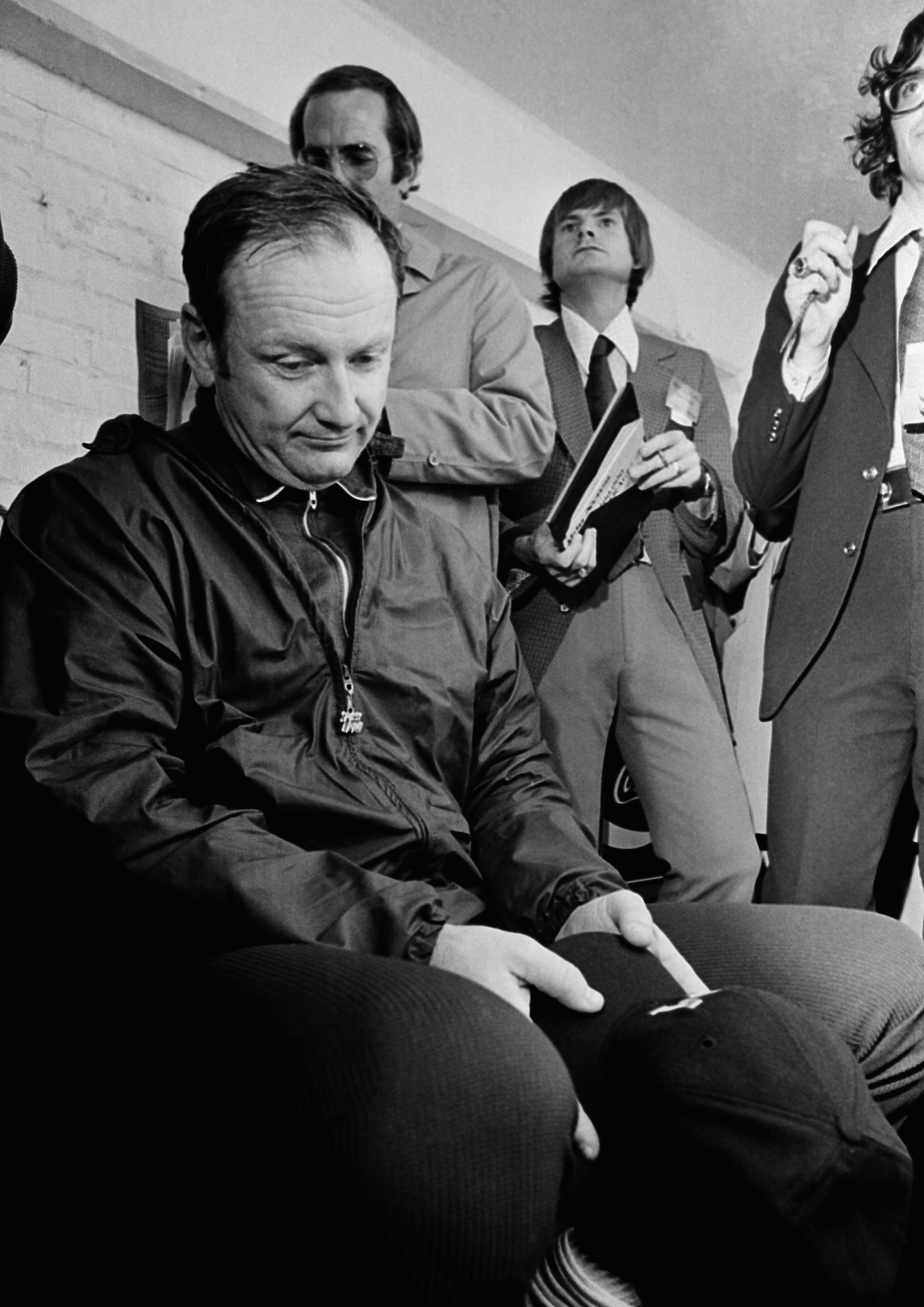 FILE - In this Nov. 24, 1973, file photo, Michigan football coach Bo Schembechler bows his head as he is interviewed after a 10-10 tie against Ohio State, in Ann Arbor, Mich.  (AP Photo/File)