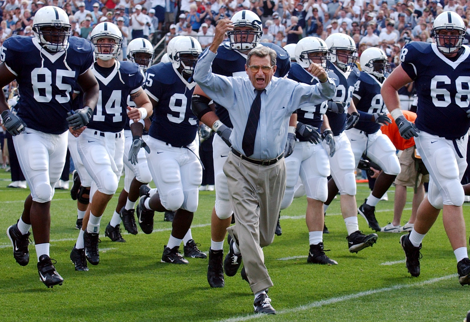 FILE - In this Sept. 4, 2004 file photo, Penn State coach Joe Paterno leads his team onto the field before an NCAA college football game against Akron in State College, Pa. As Penn State's athletic department finalizes details for how to honor the 50th an