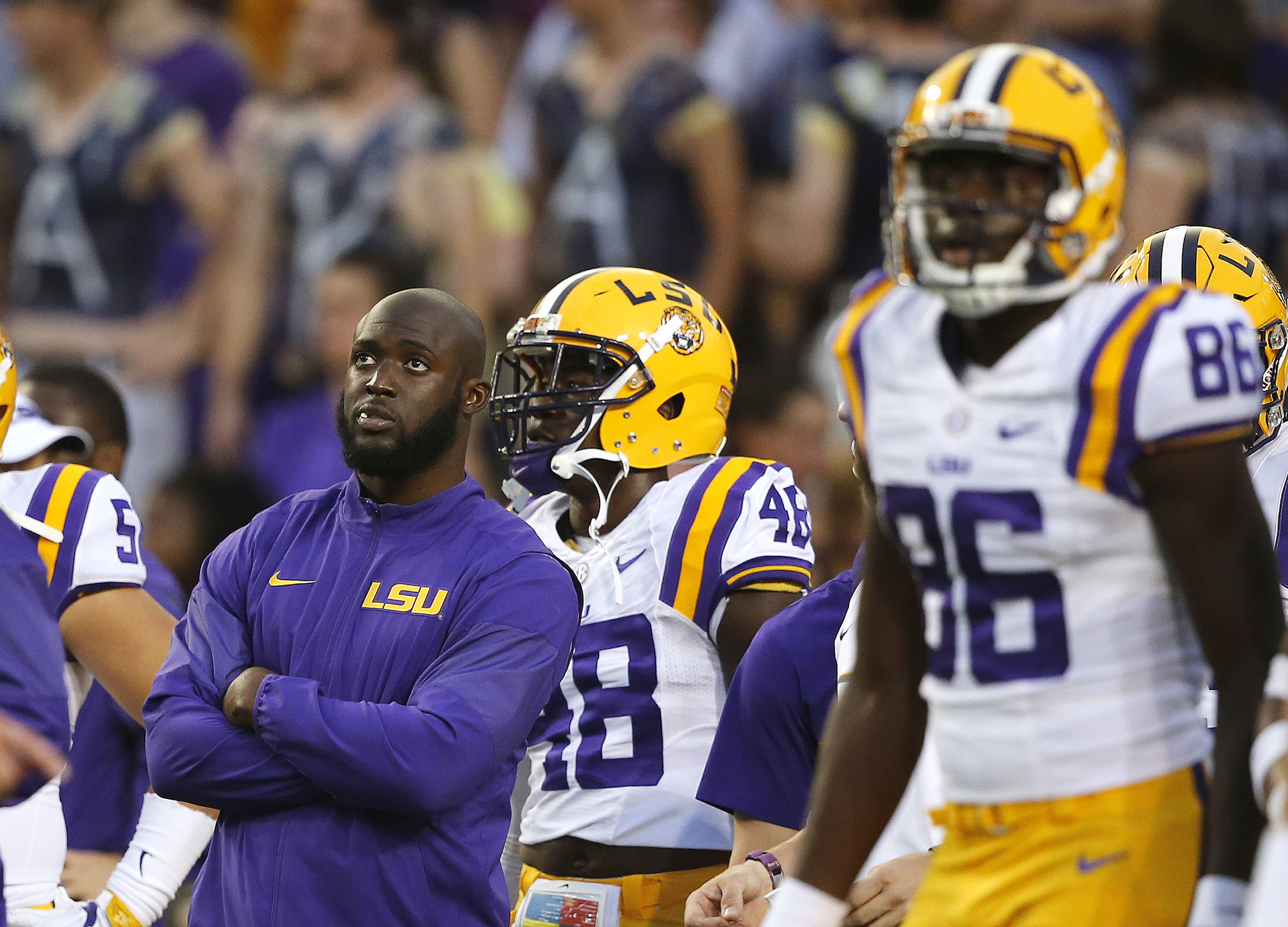 FILE - In this Sept. 10, 2016, file photo, LSU running back Leonard Fournette, left, watches players warm up for an NCAA college football game against Jacksonville State in Baton Rouge, La., Fournette did not play in the game. Regardless of how much Fourn