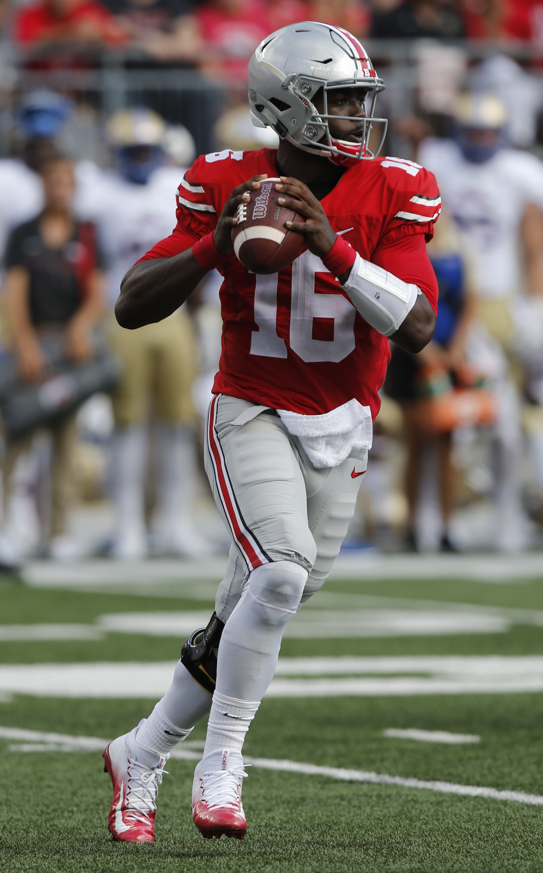 FILE - In this Sept 10, 2016, file photo, Ohio State quarterback J.T. Barrett looks for a receiver during an NCAA college football game against Tulsa in Columbus, Ohio.  Barrett has accounted for nine touchdowns so far for the third-ranked Buckeyes, who p