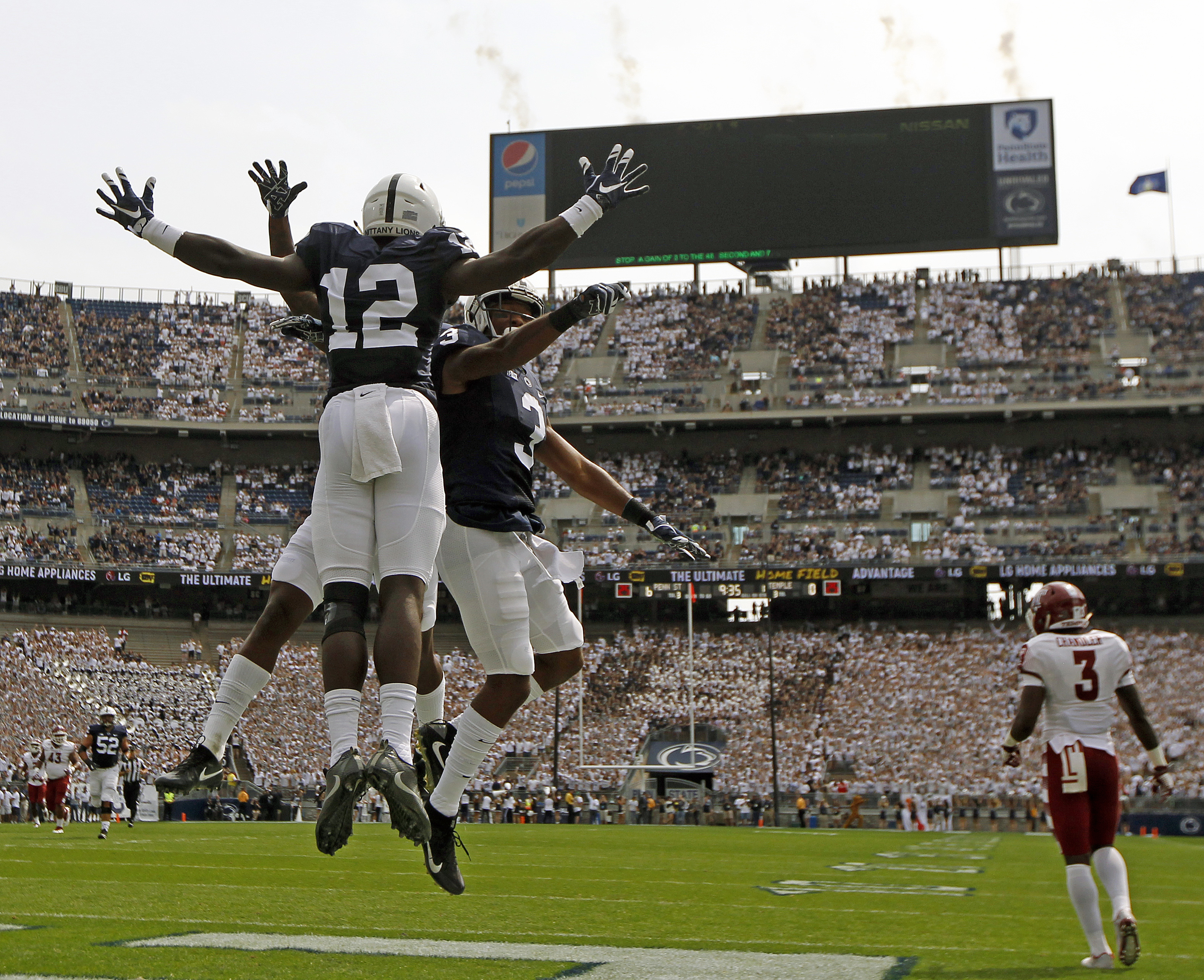 Penn State's Chris Godwin (12) celebrates with teammates after scoring a touchdown against Temple during the first half of an NCAA college football game in State College, Pa., Saturday, Sept. 17, 2016. (AP Photo/Chris Knight)