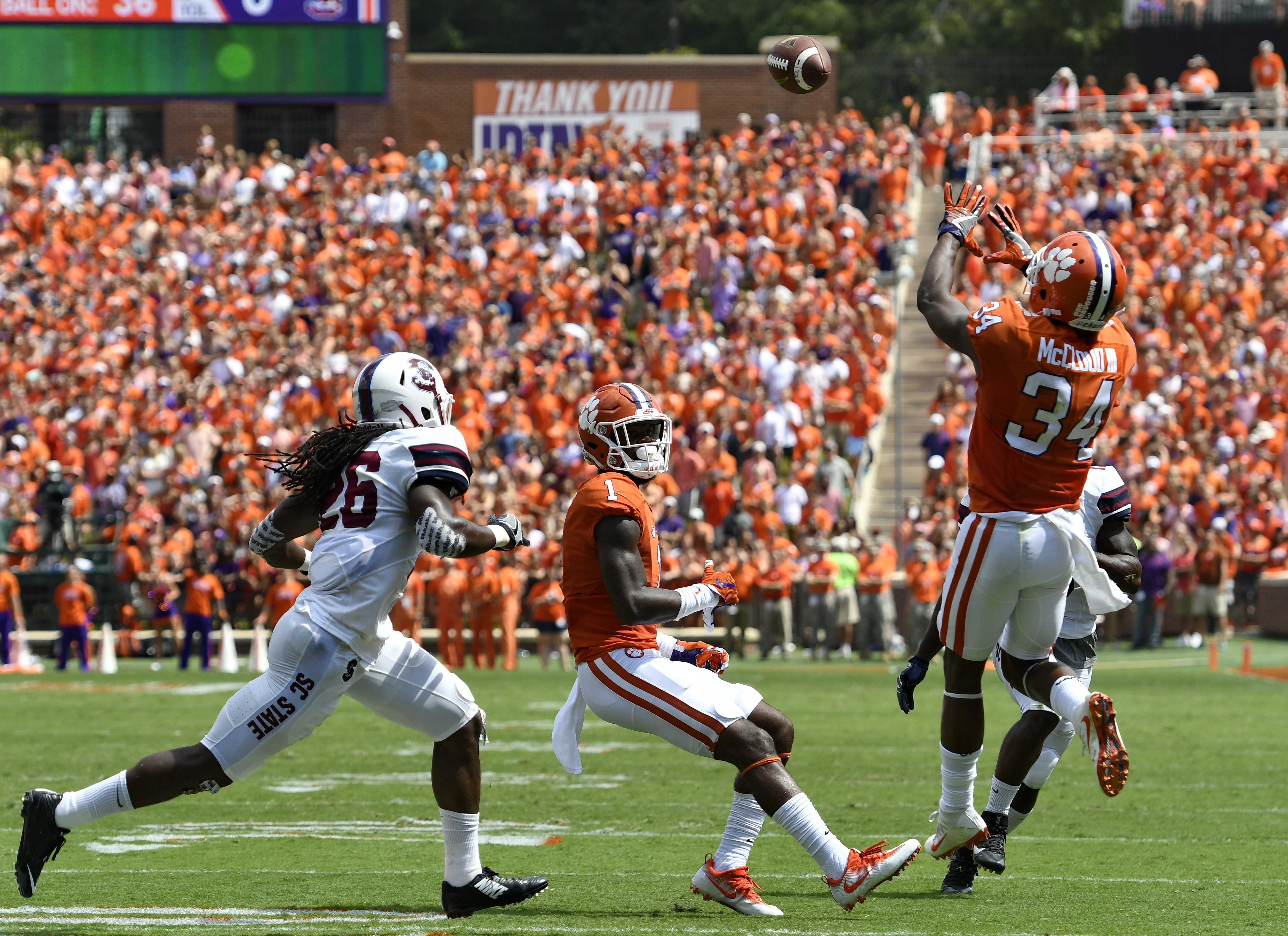 Clemson's Ray-Ray McCloud (34) pulls in a pass for a touchdown while covered by South Carolina State's Jason Baxter (26) and Clemson's Trevion Thompson watches during the first half of an NCAA college football game Saturday, Sept. 17, 2016, in Clemson, S.