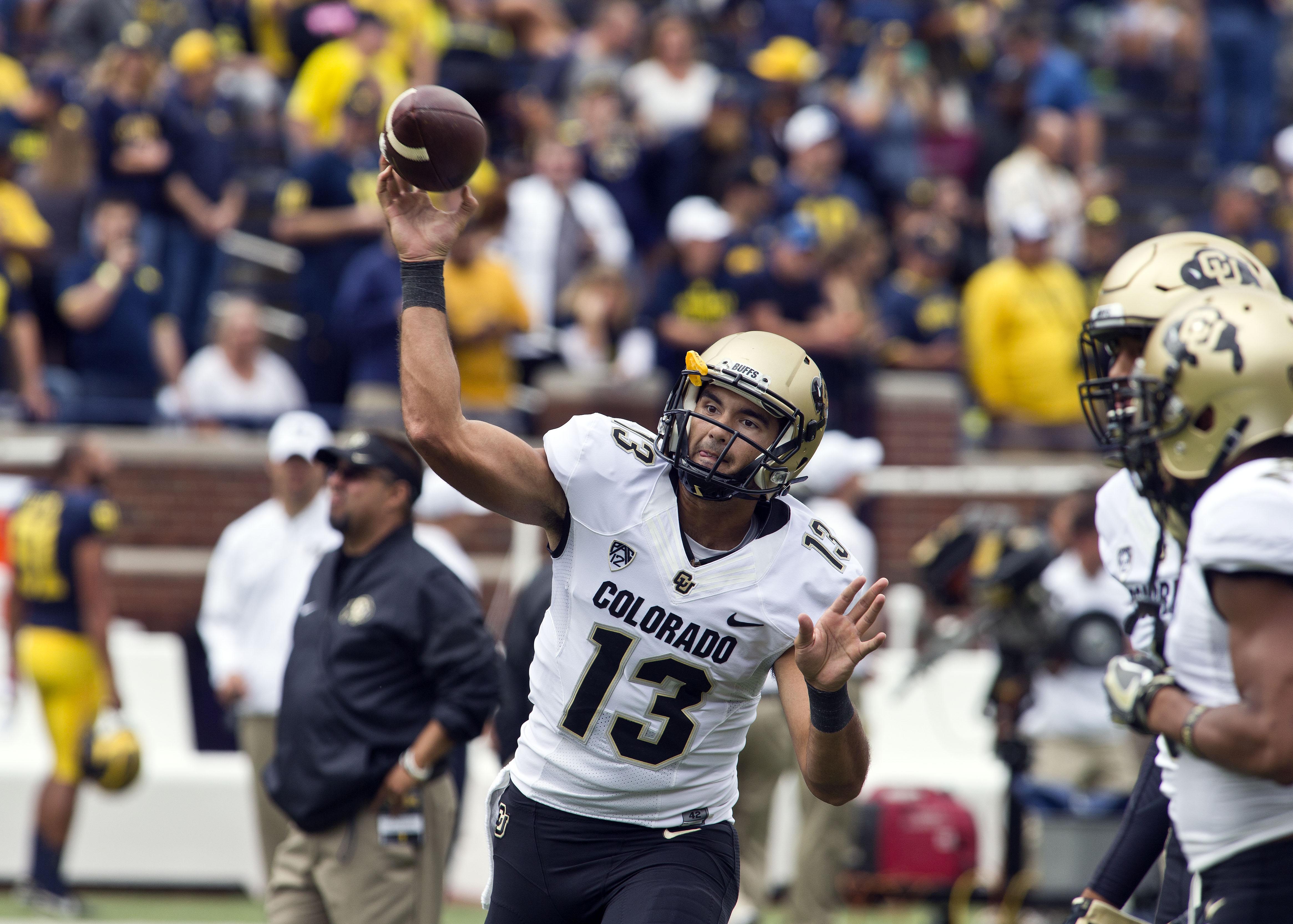 Colorado quarterback Sefo Liufau throws a pass during warmups before an NCAA college football game against Michigan at Michigan Stadium in Ann Arbor, Mich., Saturday, Sept. 17, 2016. (AP Photo/Tony Ding)