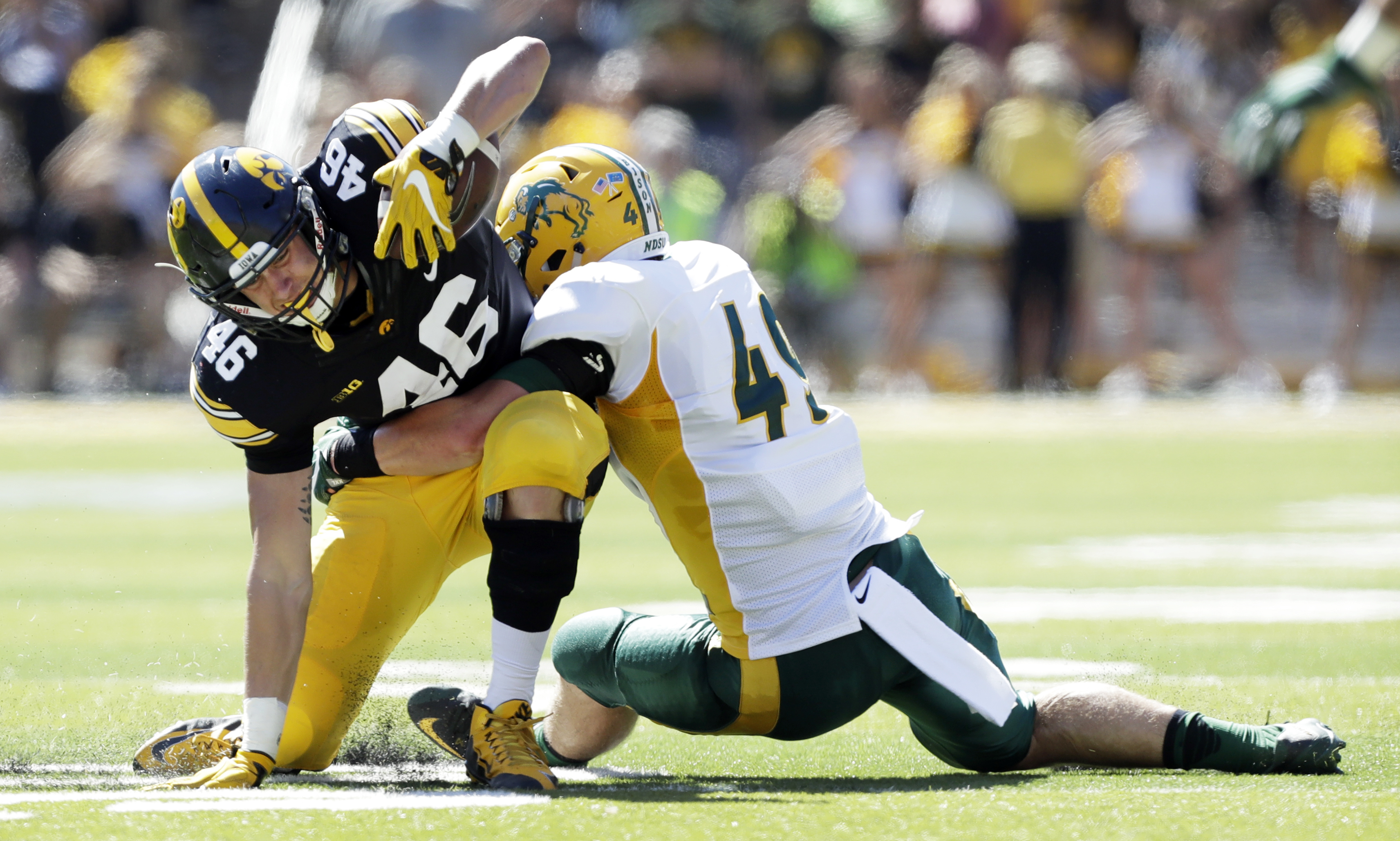 Iowa tight end George Kittle (46) is tackled by North Dakota State linebacker Nick DeLuca, right, after making a reception during the first half of an NCAA college football game, Saturday, Sept. 17, 2016, in Iowa City, Iowa. North Dakota State won 23-21.