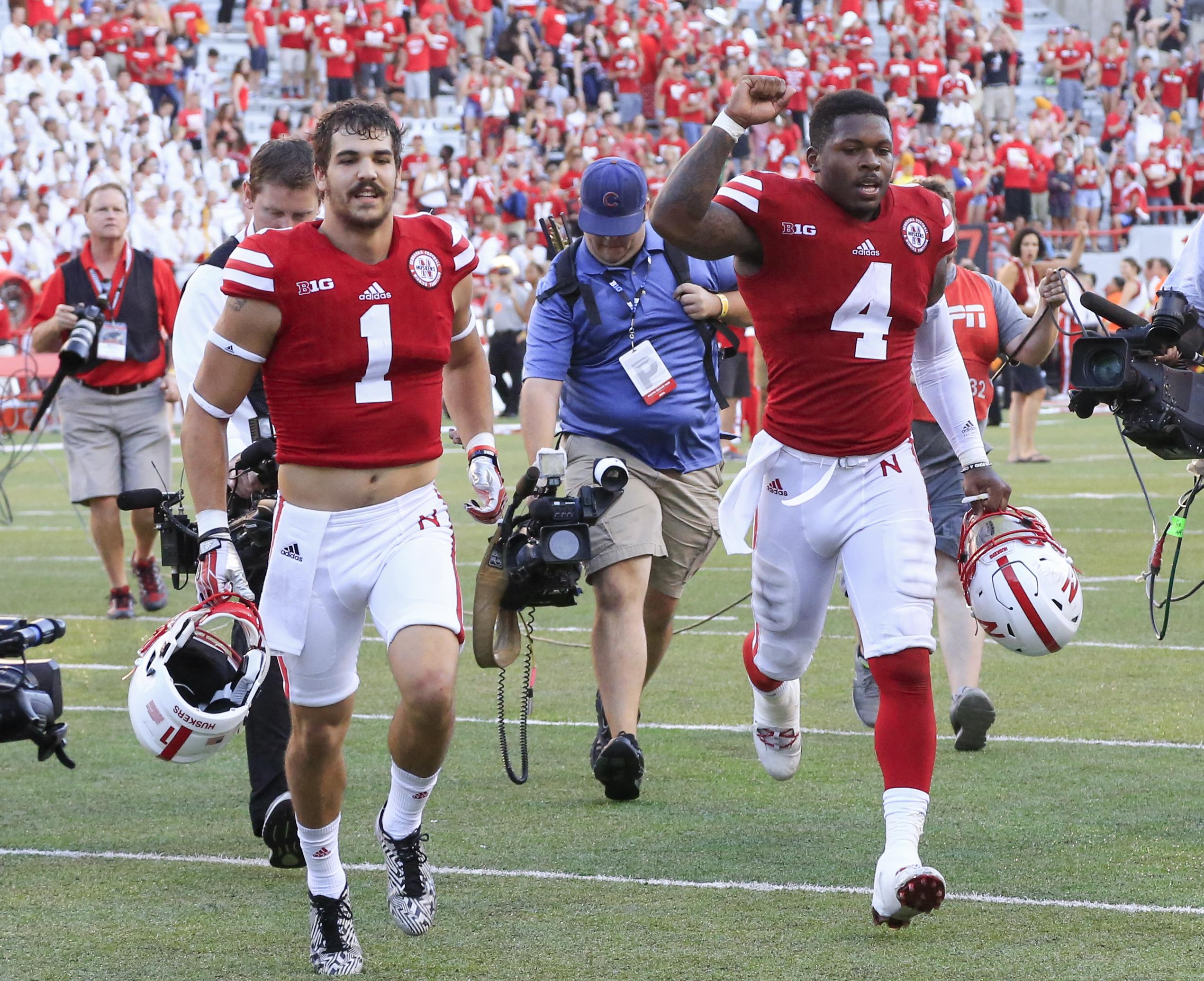 Nebraska quarterback Tommy Armstrong Jr. (4) and wide receiver Jordan Westerkamp (1) run off the field following an NCAA college football game against Oregon in Lincoln, Neb., Saturday, Sept. 17, 2016. Nebraska won 35-32. (AP Photo/Nati Harnik)