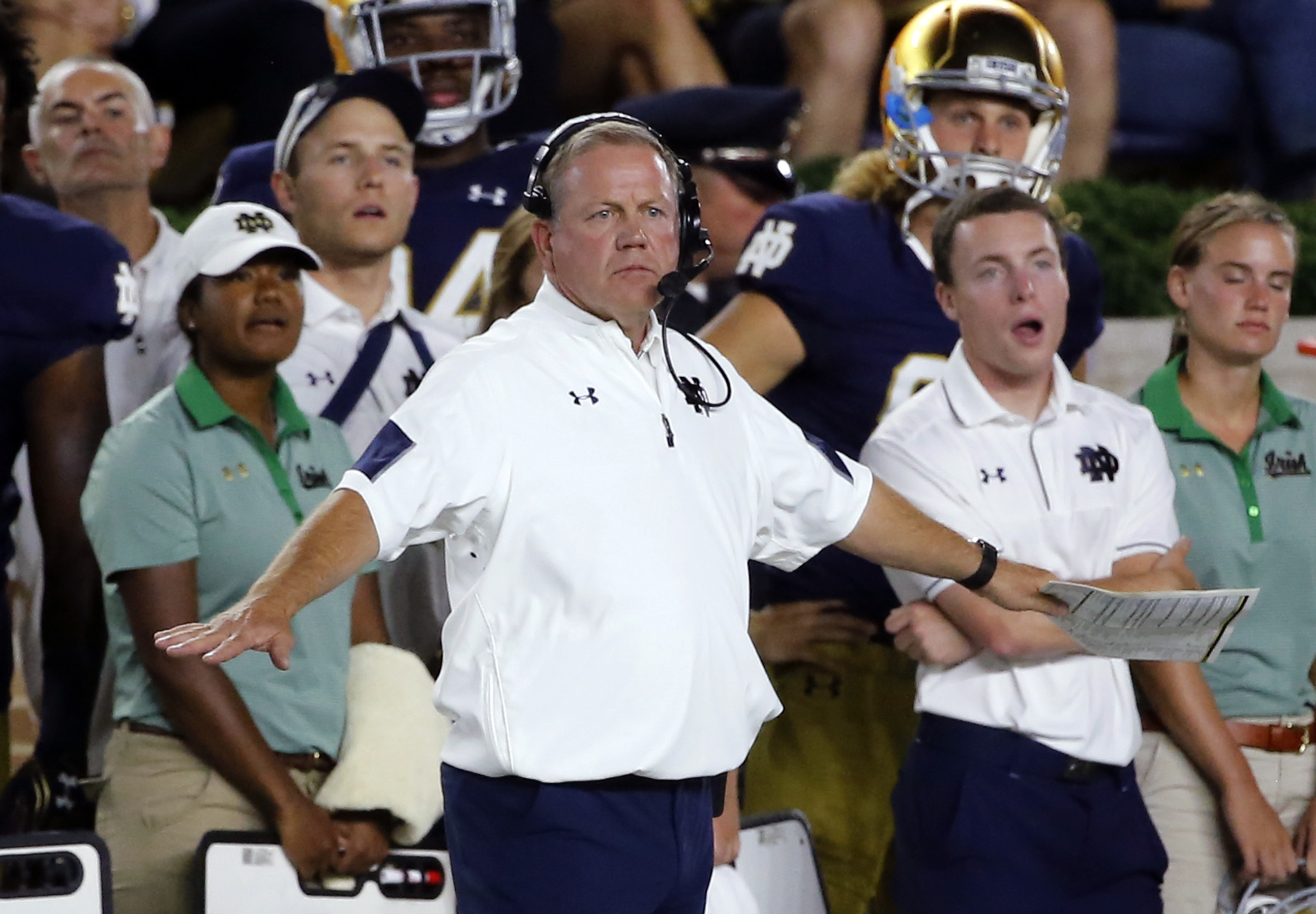Notre Dame head coach Brian Kelly signals from the sideline during the first half of an NCAA college football game against Michigan State, Saturday, Sept. 17, 2016, in South Bend, Ind. (AP Photo/Charles Rex Arbogast)