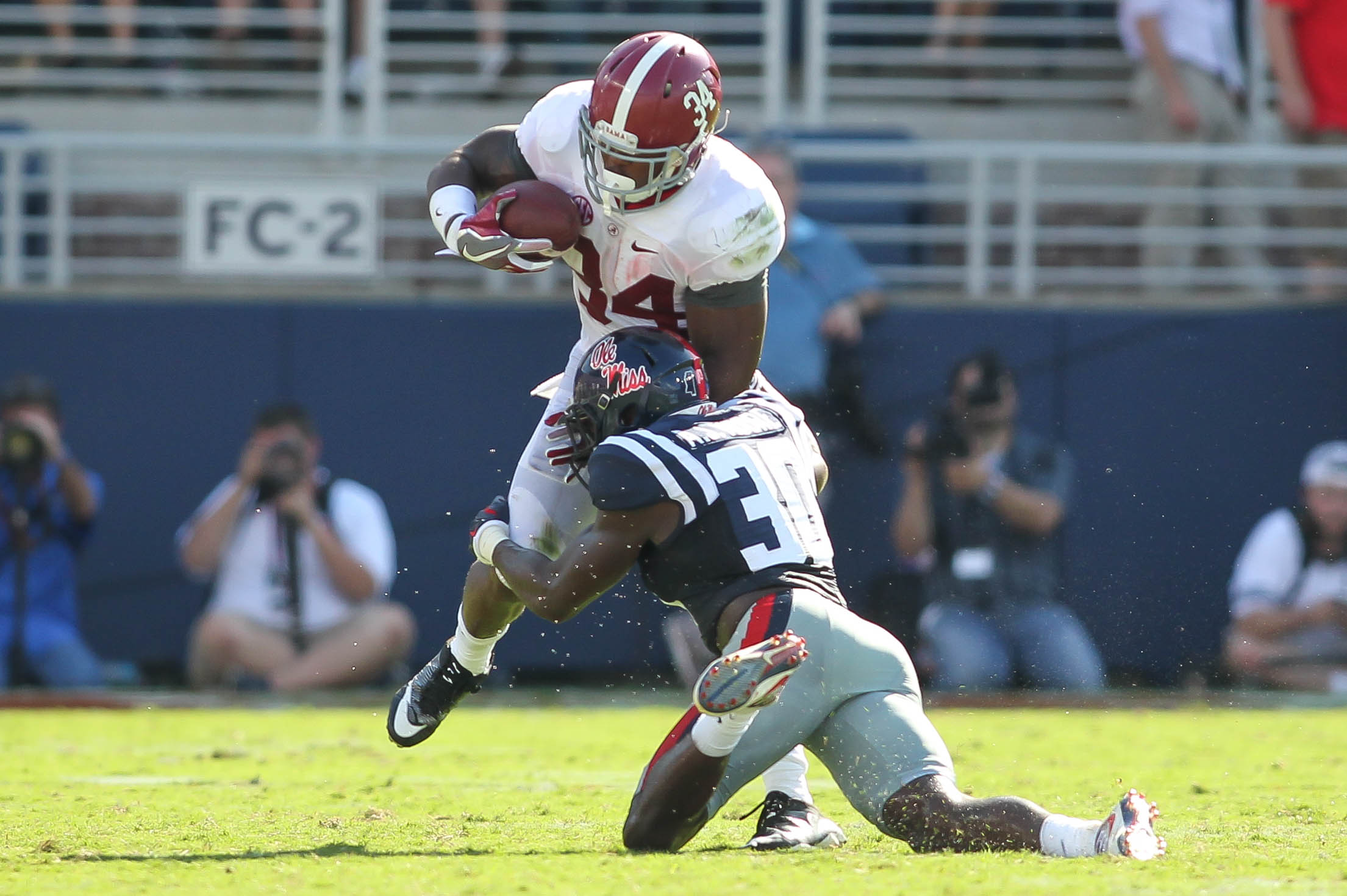 Alabama running back Damien Harris (34) tries to avoid the tackle from Mississippi defender A.J. Moore (30) during their NCAA football game at Vaught-Hemingway Stadium in Oxford, Miss., Saturday, Sept. 17, 2016. Alabama won 48-43. (James Pugh/The Laurel C